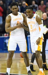 Tennessee guard Admiral Schofield (5) and Tennessee guard Jordan Bone (0) celebrate after their 77-70 win over Colgate in the first round of the NCAA Tournament at Nationwide Arena in Columbus, Ohio, on Friday, March 22, 2019.