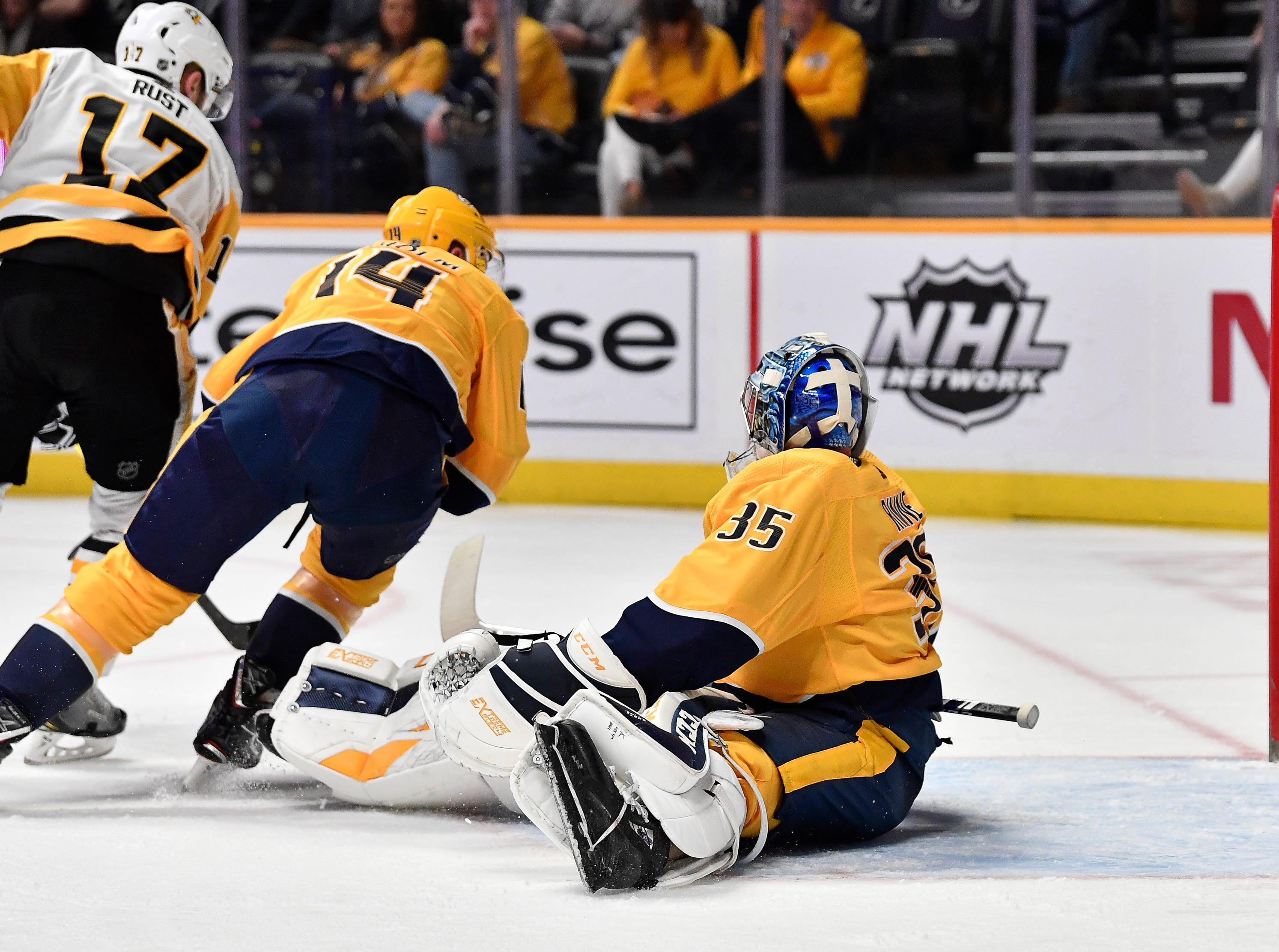 Penguins right wing Bryan Rust (17) scores a goal past Predators defenseman Mattias Ekholm (14) and goaltender Pekka Rinne (35) during the second period at Bridgestone Arena Thursday, March 21, 2019 in Nashville, Tenn.