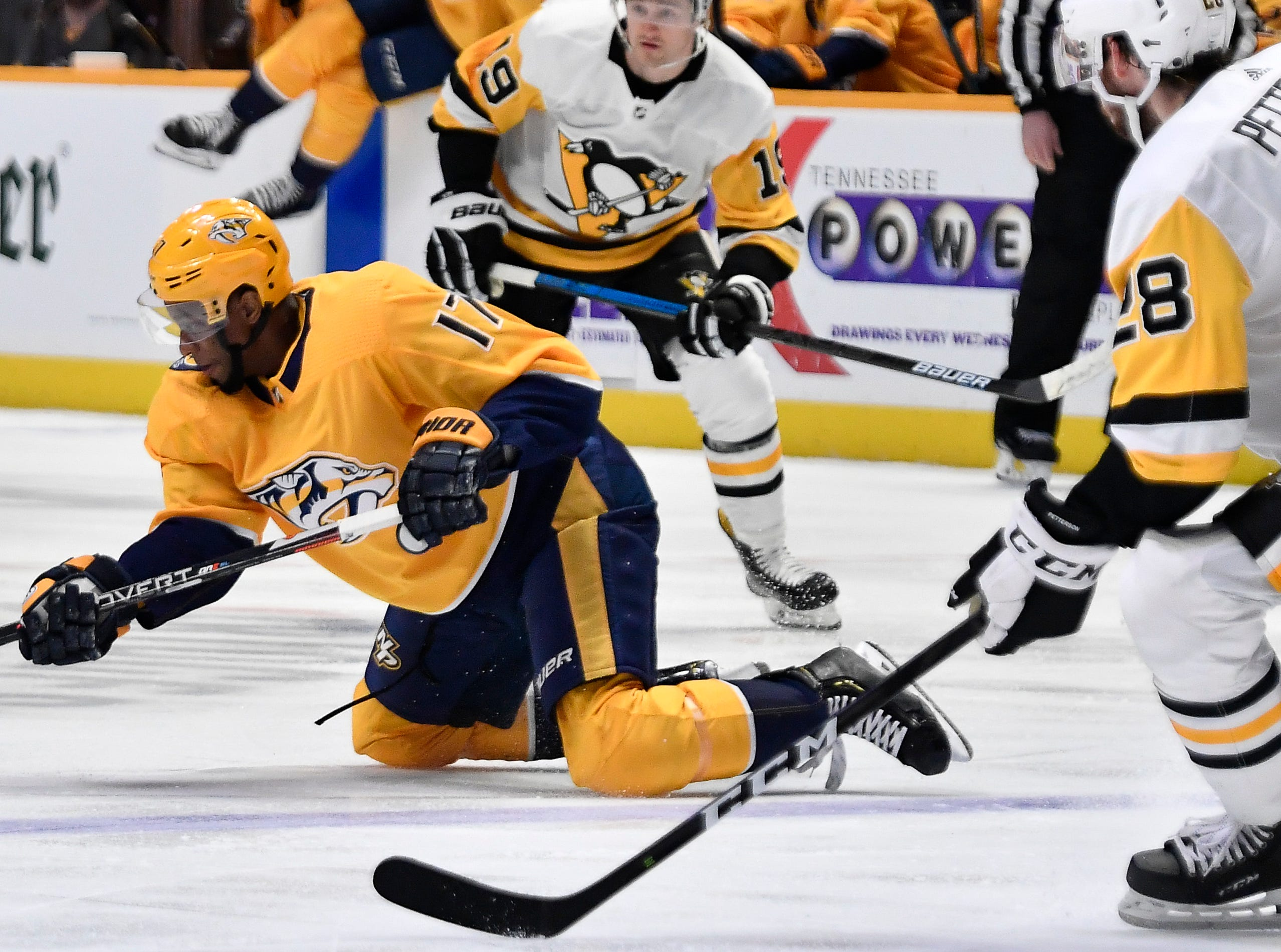 Predators right wing Wayne Simmonds (17) tries to shoot the puck past Penguins defenseman Marcus Pettersson (28) during the first period at Bridgestone Arena Thursday, March 21, 2019 in Nashville, Tenn.