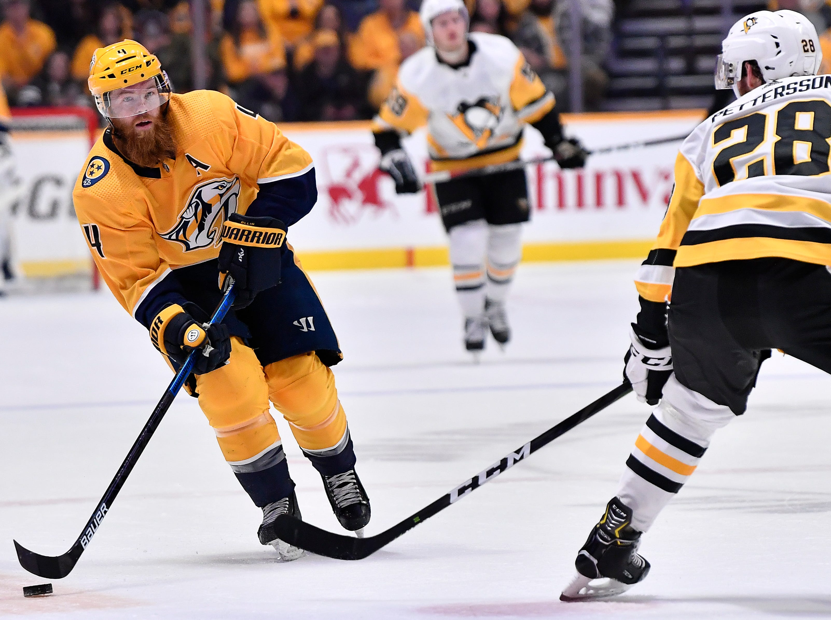 Predators defenseman Ryan Ellis (4) tries to take a last second shot past Penguins defenseman Marcus Pettersson (28) during the first period at Bridgestone Arena Thursday, March 21, 2019 in Nashville, Tenn.