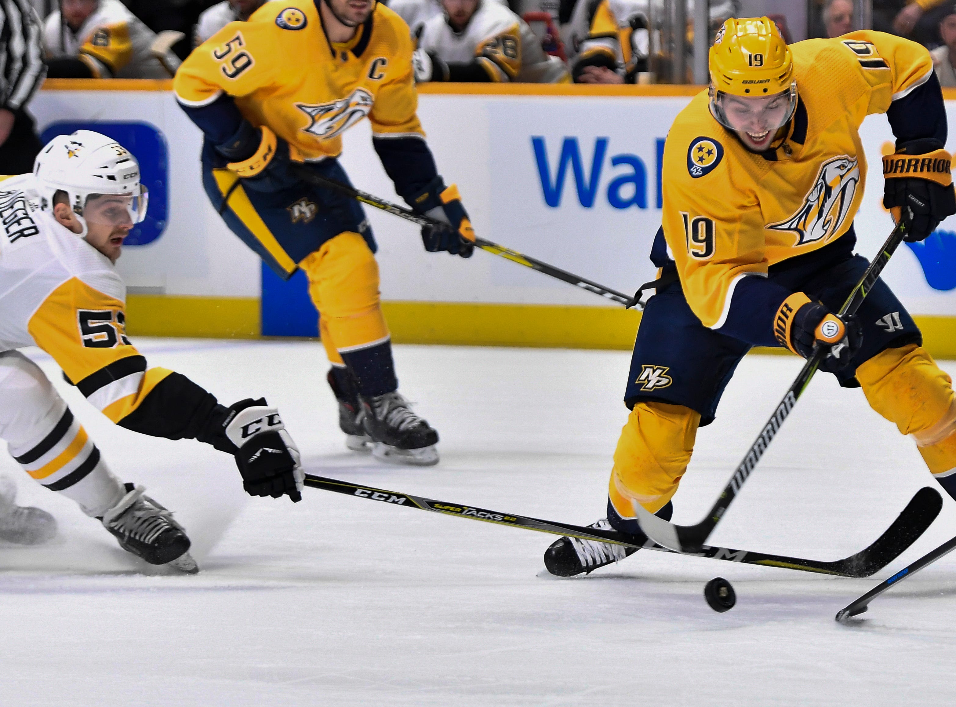 Predators center Calle Jarnkrok (19) shoots past Penguins center Teddy Blueger (53) during the first period at Bridgestone Arena Thursday, March 21, 2019 in Nashville, Tenn.