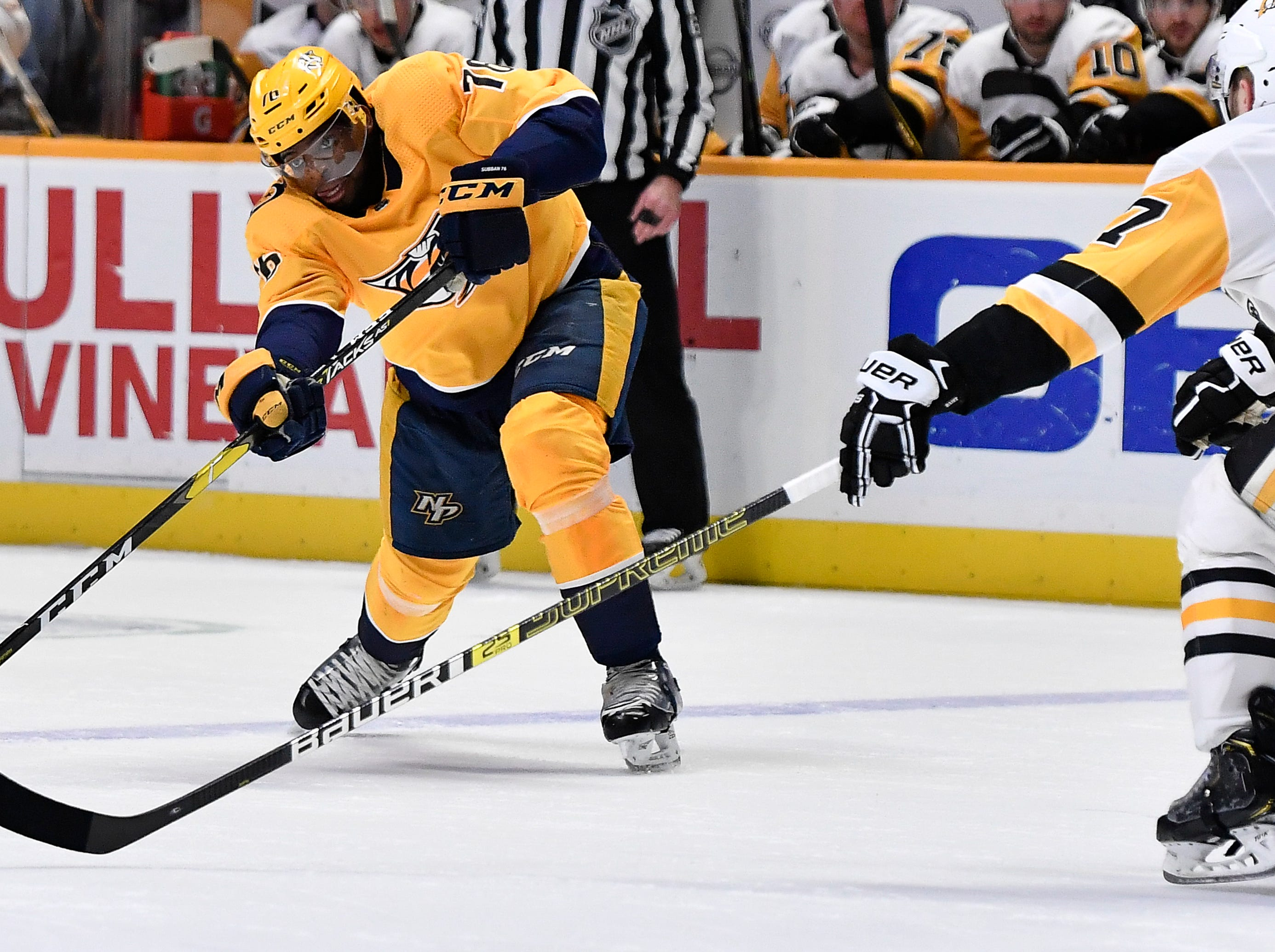 Predators defenseman P.K. Subban (76) passes the puck past Penguins right wing Bryan Rust (17) during the third period at Bridgestone Arena Thursday, March 21, 2019 in Nashville, Tenn.