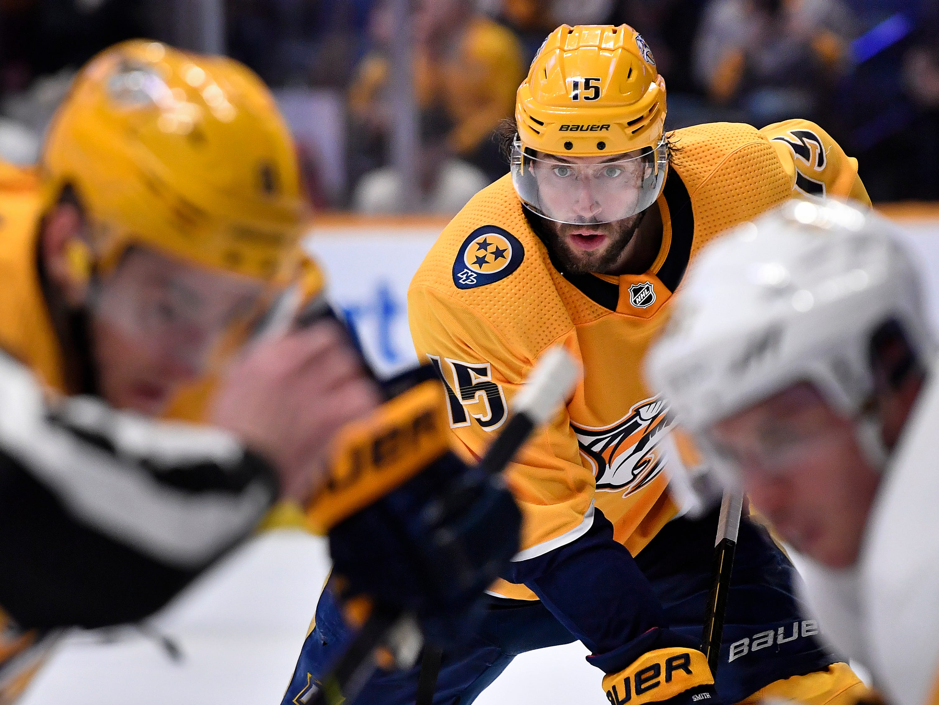 Predators right wing Craig Smith (15) waits for play to begin during the third period against the Penguins  at Bridgestone Arena Thursday, March 21, 2019 in Nashville, Tenn.