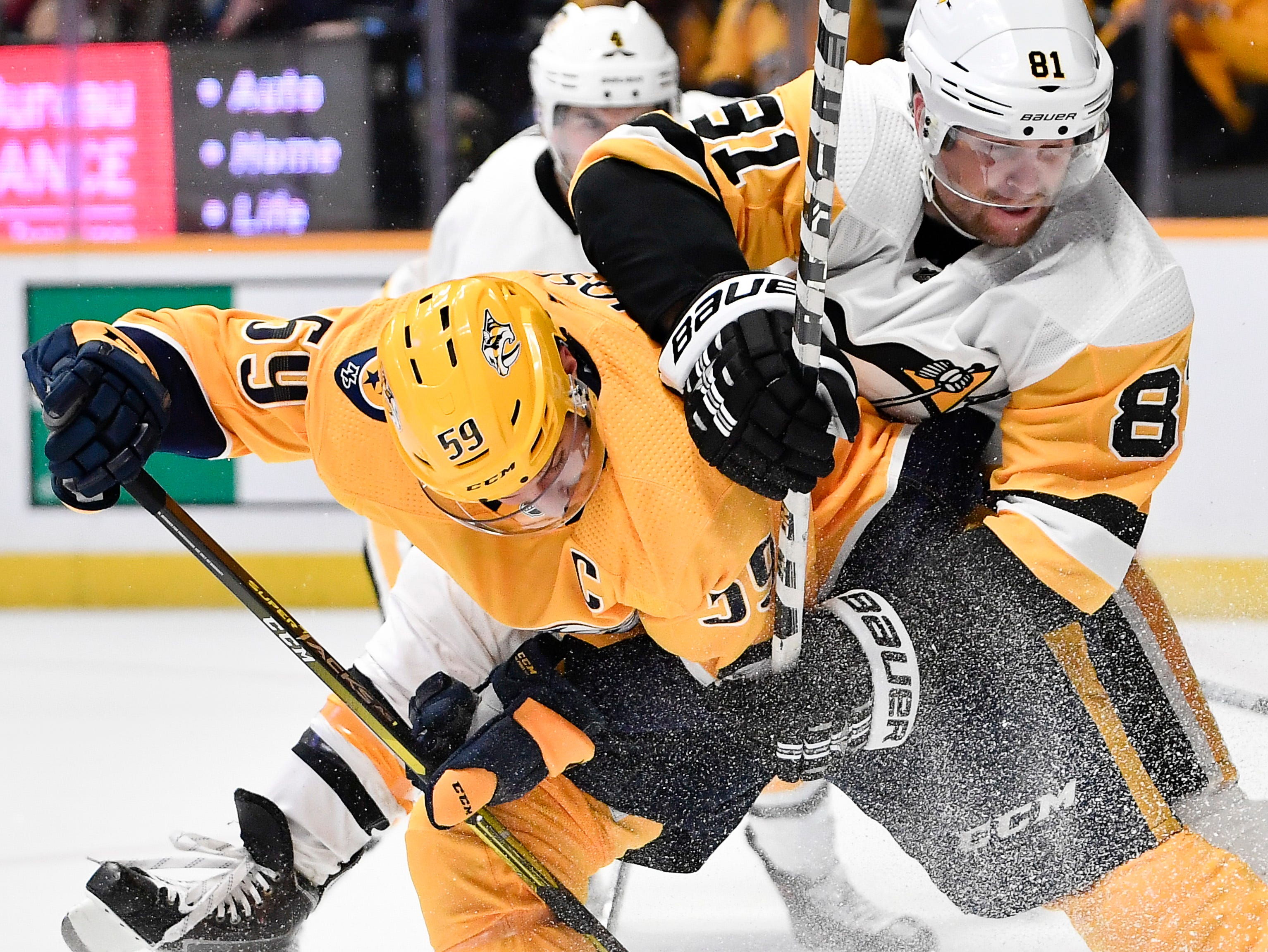 Predators defenseman Roman Josi (59) tries t shoot the puck past Penguins right wing Phil Kessel (81) during the third period at Bridgestone Arena Thursday, March 21, 2019 in Nashville, Tenn.