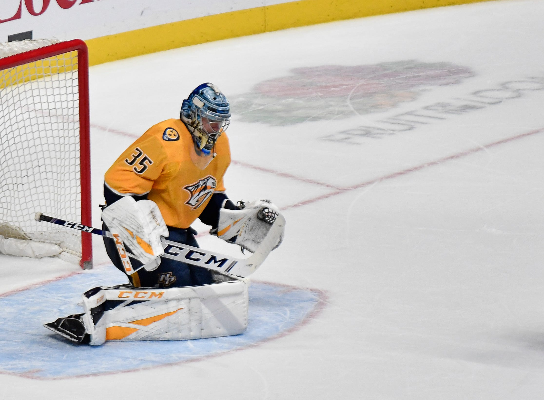 Penguins center Sidney Crosby (87) scores a goal past Predators goaltender Pekka Rinne (35) during a shootout in overtime at Bridgestone Arena Thursday, March 21, 2019 in Nashville, Tenn.