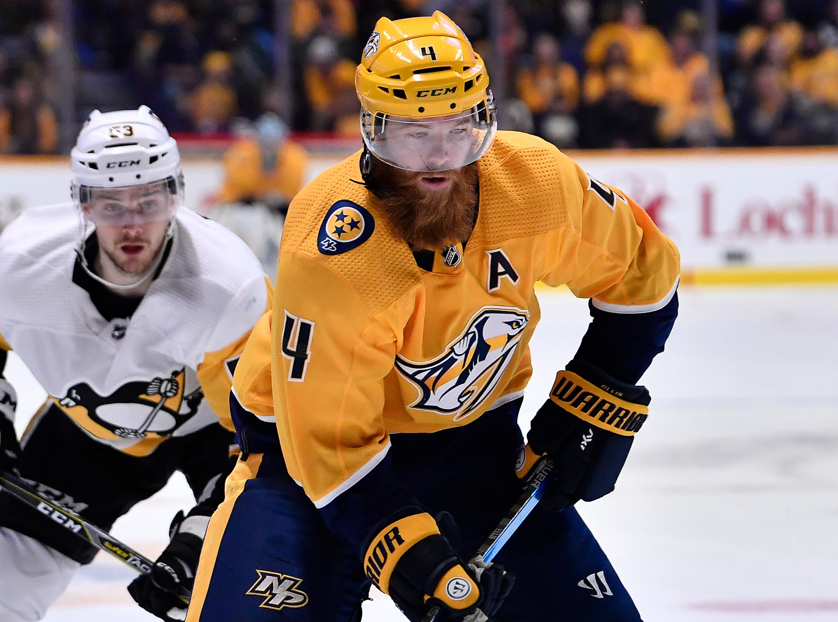 Predators defenseman Ryan Ellis (4) speeds past a Penguins defender during the third period at Bridgestone Arena Thursday, March 21, 2019 in Nashville, Tenn.