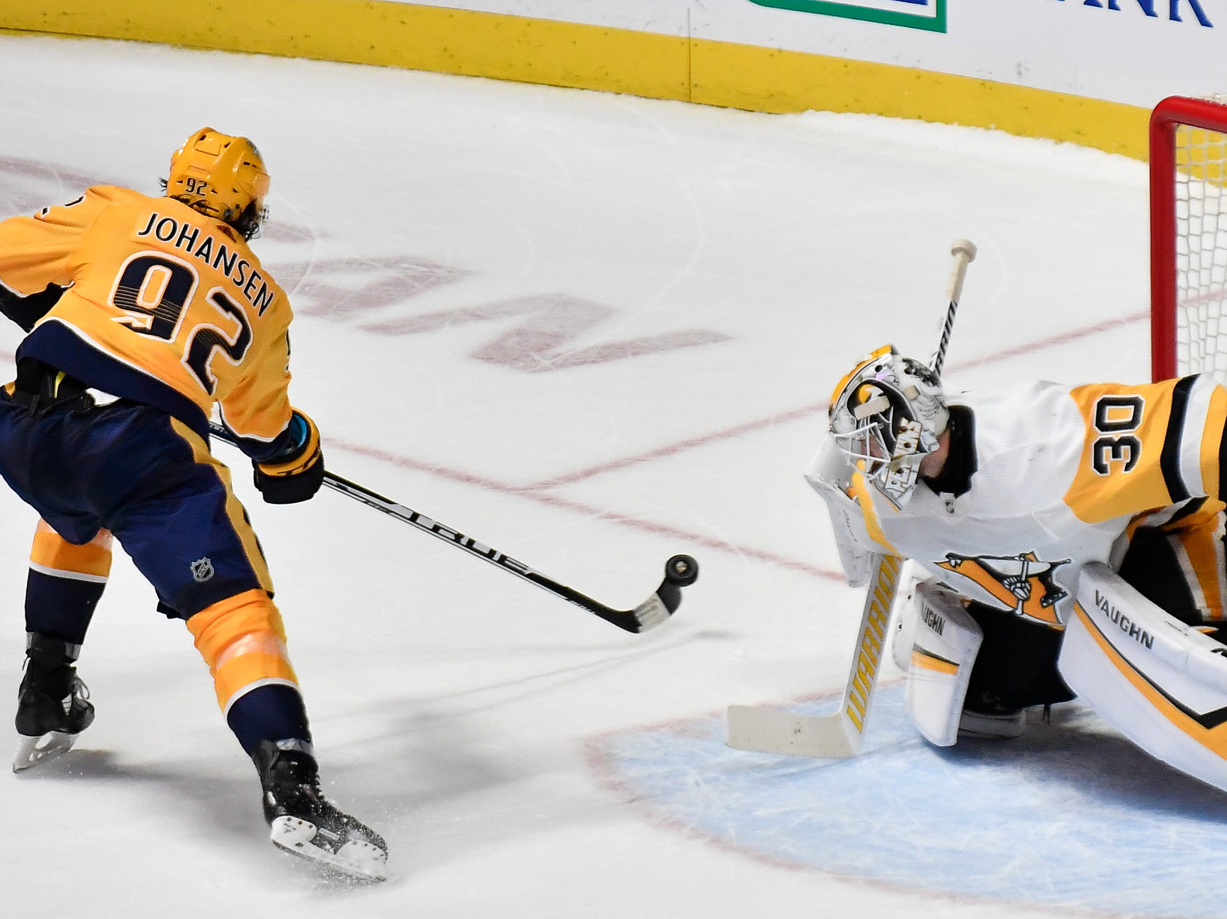 Penguins goaltender Matt Murray (30) blocks a shot on goal by Predators center Ryan Johansen (92) during an overtime shootout at Bridgestone Arena Thursday, March 21, 2019 in Nashville, Tenn.