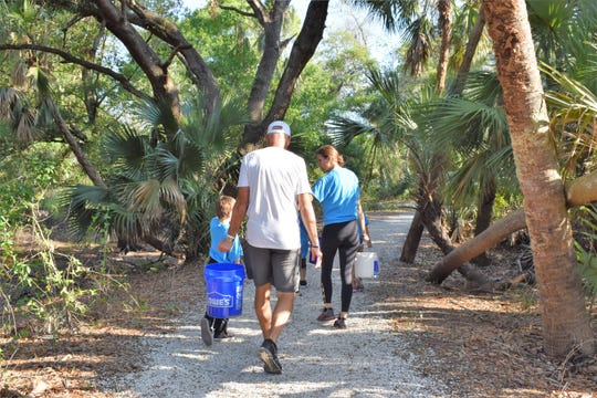 People participate in the Rotary Club of Estero's Walk for Water event in 2018.
