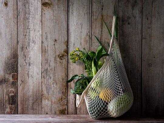 Reusable mesh or string produce bags make grocery shopping more environmentally friendly.