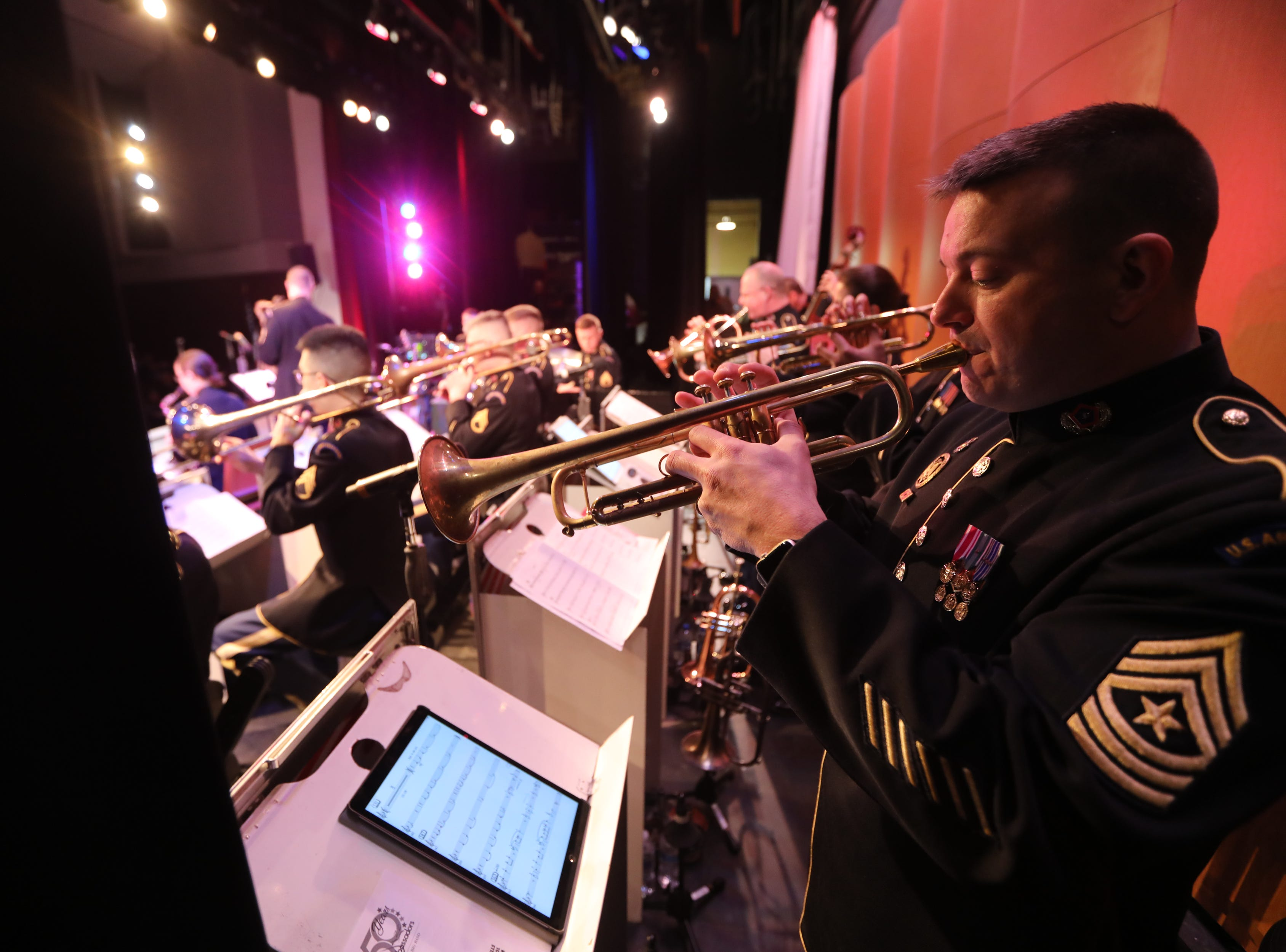 Sgt. Major John Altman plays the trumpet in Wayne.  The United States Army Jazz Ambassadors Field Band performed at Wayne Hills High School, Thursday, March 21, 2019.  This was the eleventh day of their tour, which lasts more than a month.