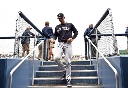 Mar 20, 2019; West Palm Beach, FL, USA; New York Yankees first baseman Greg Bird (33) heads into the dugout before a spring training game against the Houston Astros at FITTEAM Ballpark of the Palm Beaches.