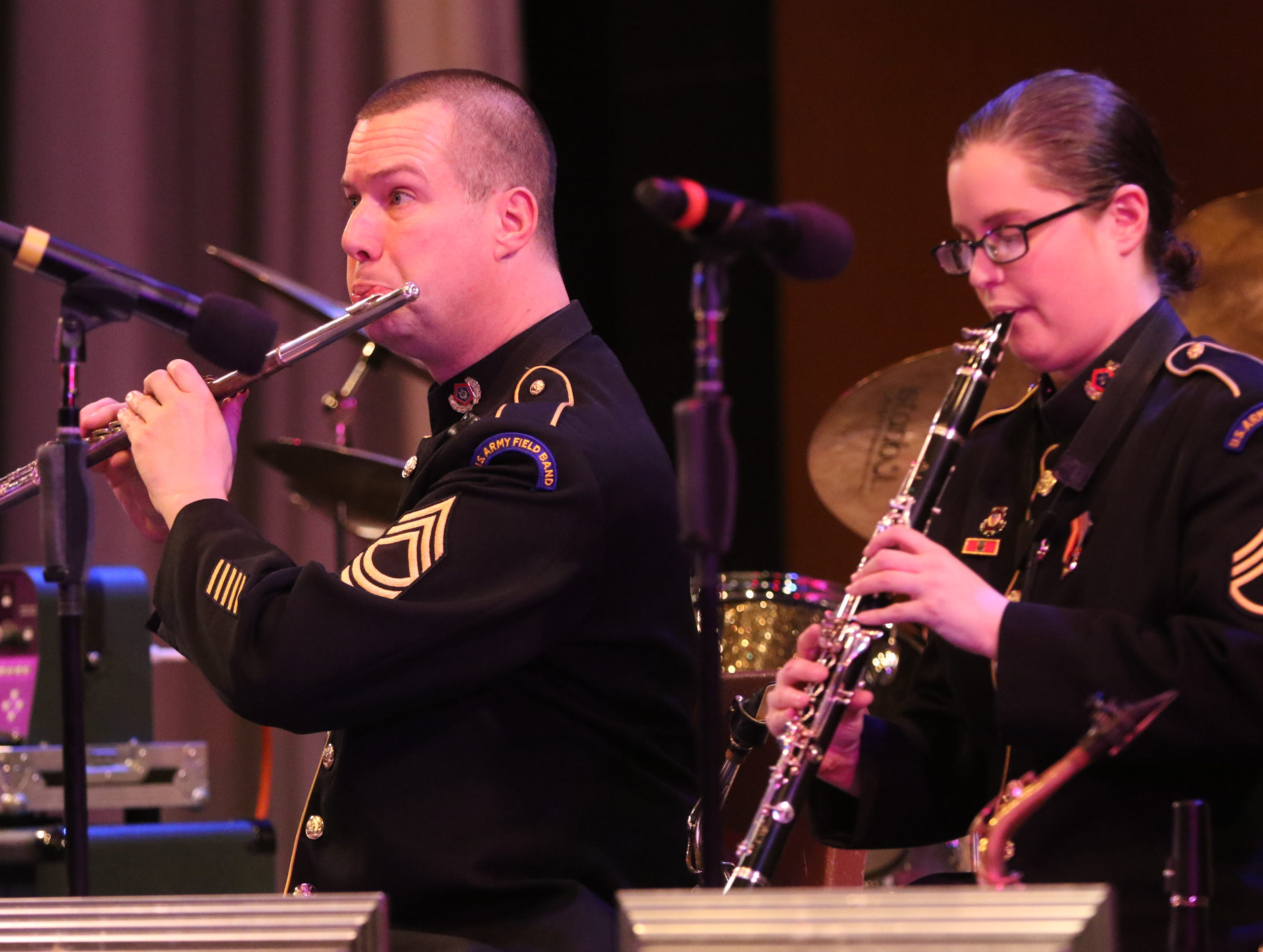 Master Sgt.Pat Shook plays the flute, in Wayne.  The United States Army  Jazz Ambassadors Field Band performed at Wayne Hills High School, Thursday, March 21, 2019.  This was the eleventh day of their tour, which lasts more than a month.
