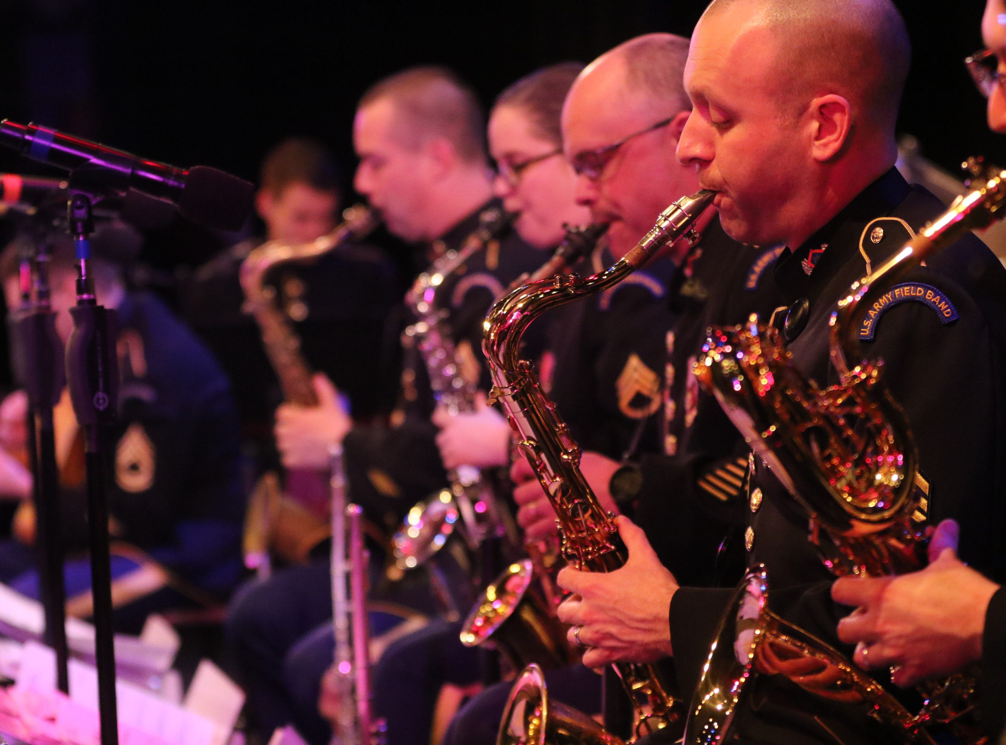 Master Sgt.Bradford Danho and others play the saxophone, in Wayne.  The United States Army Jazz Ambassadors Field Band performed at Wayne Hills High School, Thursday, March 21, 2019.  This was the eleventh day of their tour, which lasts more than a month.