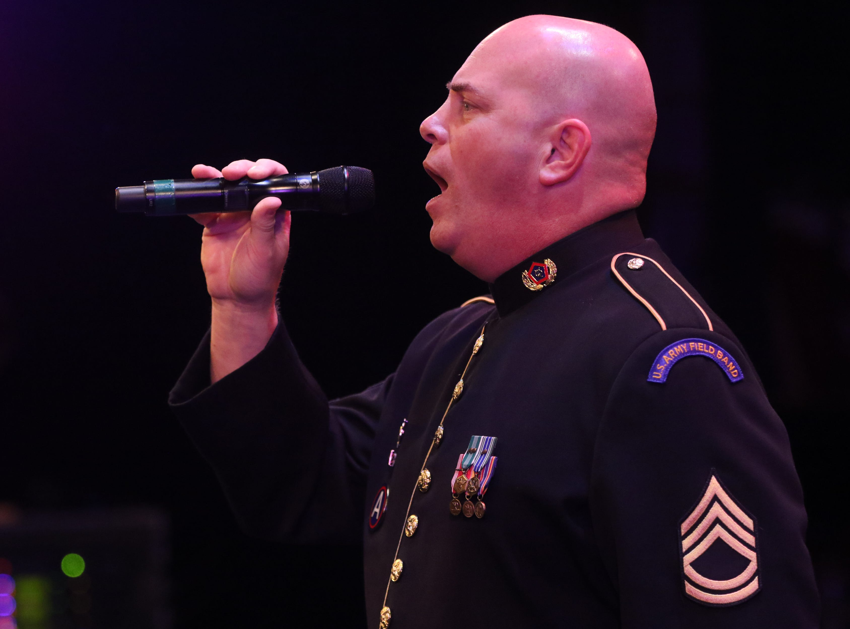 Sgt. First Class Randy Wright sings 'The Star-Spangled Banner', in Wayne.  The United States Army Jazz Ambassadors Field Band performed at Wayne Hills High School, Thursday, March 21, 2019.  This was the eleventh day of their tour, which lasts more than a month.