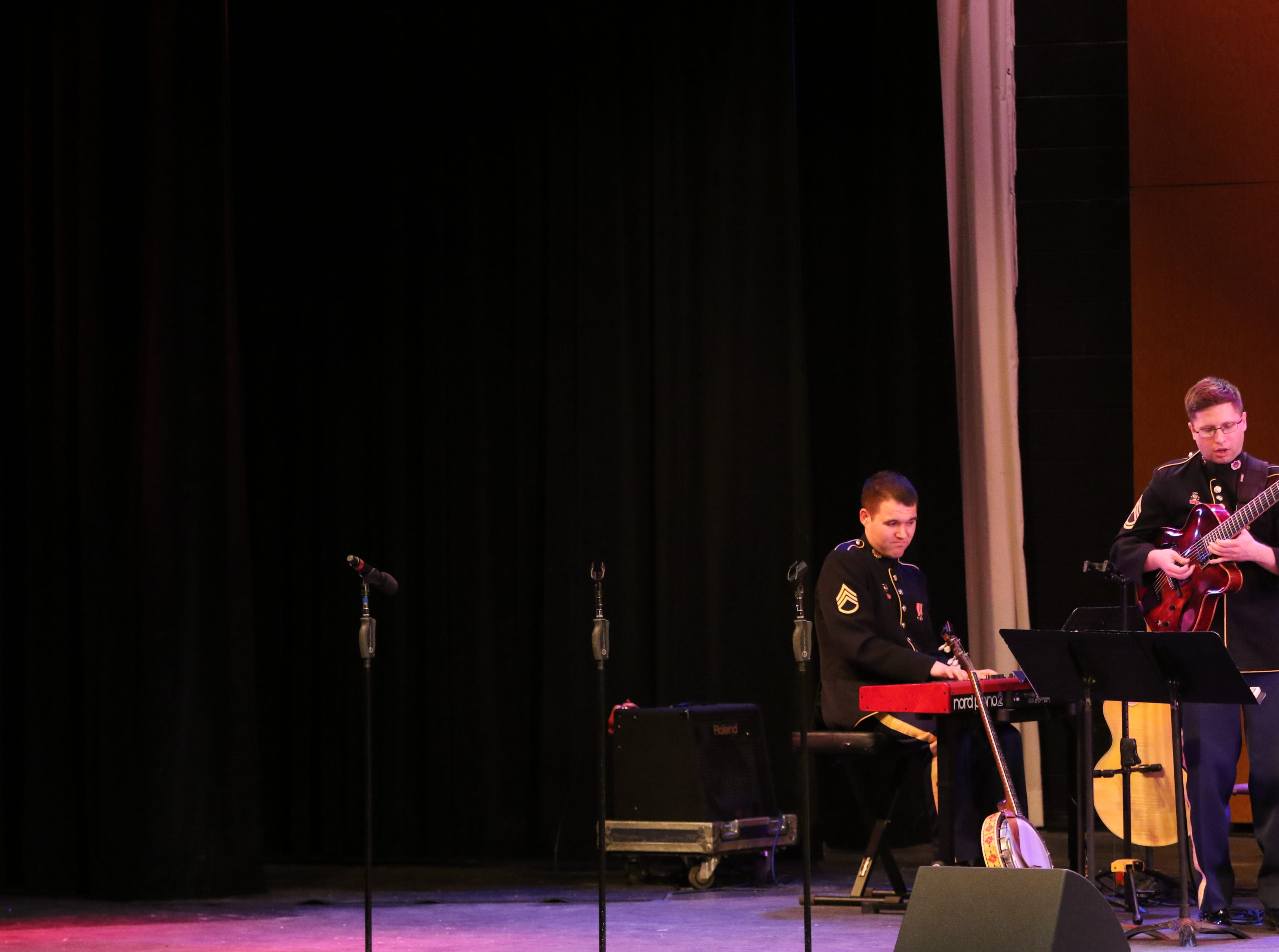 Staff Sgt. Anthony Pocetti, of Hamilton, NJ, plays the piano, while Sgt. First Class Jonathan Epley, of Greenville, TN. plays the guitar.  The United States Army Jazz Ambassadors Field Band performed at Wayne Hills High School, Thursday, March 21, 2019.  This was the eleventh day of their tour, which lasts more than a month.