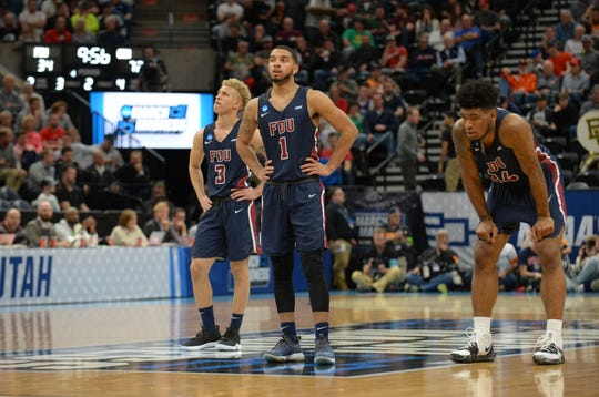 Mar 21, 2019; Salt Lake City, UT, USA; Fairleigh Dickinson Knights players Jahlil Jenkins (3) , Darnell Edge (1) and Mike Holloway Jr. (34) react against the Gonzaga Bulldogs in the second half in the first round of the 2019 NCAA Tournament at Vivint Smart Home Arena.
