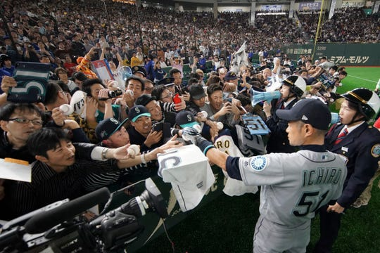 Mar 21, 2019; Tokyo,JPN; Seattle Mariners right fielder Ichiro Suzuki (51) signs autographs for fans before the game against the Oakland Athletics at Tokyo Dome.