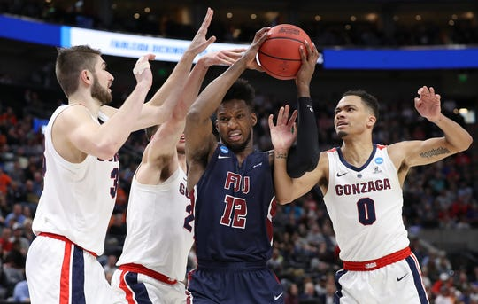 SALT LAKE CITY, UTAH - MARCH 21: Kaleb Bishop #12 of the Fairleigh Dickinson Knights drives against Killian Tillie #33, Corey Kispert #24 and Geno Crandall #0 of the Gonzaga Bulldogs during the first half in the first round of the 2019 NCAA Men's Basketball Tournament at Vivint Smart Home Arena on March 21, 2019 in Salt Lake City, Utah.