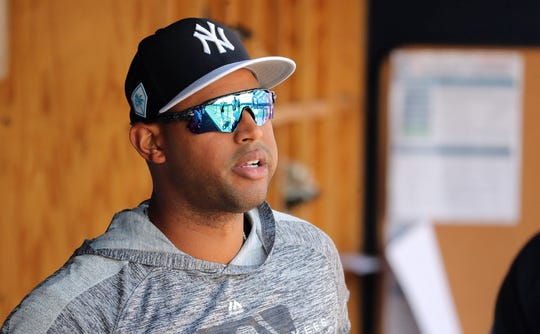 New York Yankees center fielder Aaron Hicks (31) looks on from the dugout at George M. Steinbrenner Field on March 15, 2019.