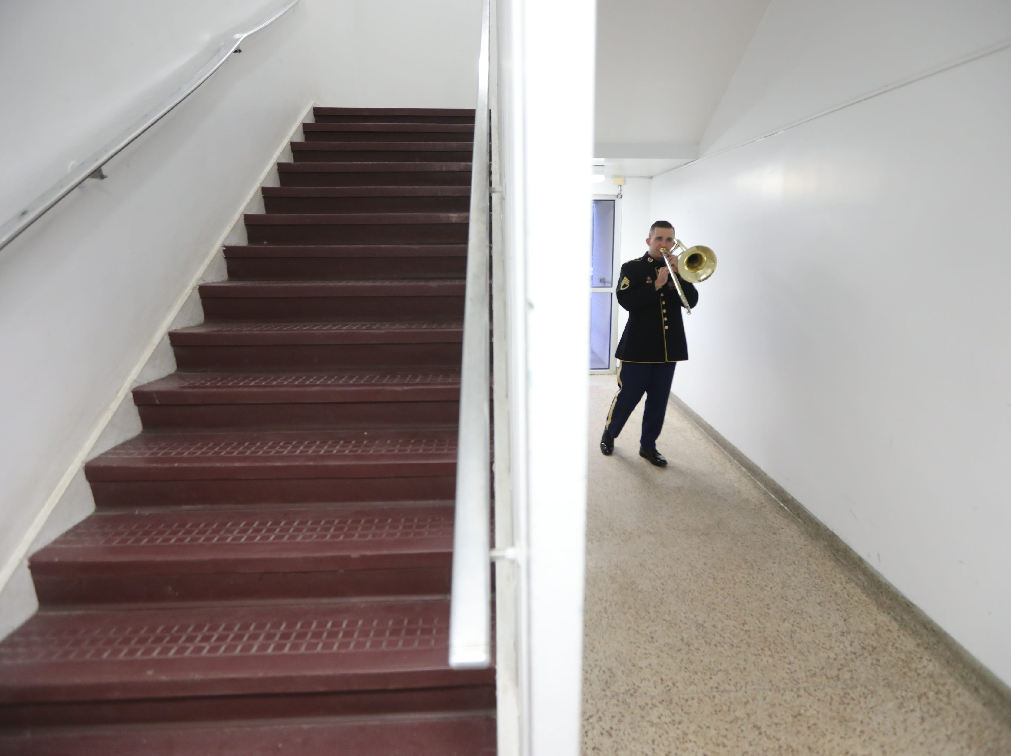 Staff Sgt. Casey practices the bass trombone, in Wayne, before the start of the concert.  The United States Army Jazz Ambassadors Field Band performed at Wayne Hills High School, Thursday, March 21, 2019.  This was the eleventh day of their tour, which lasts more than a month.