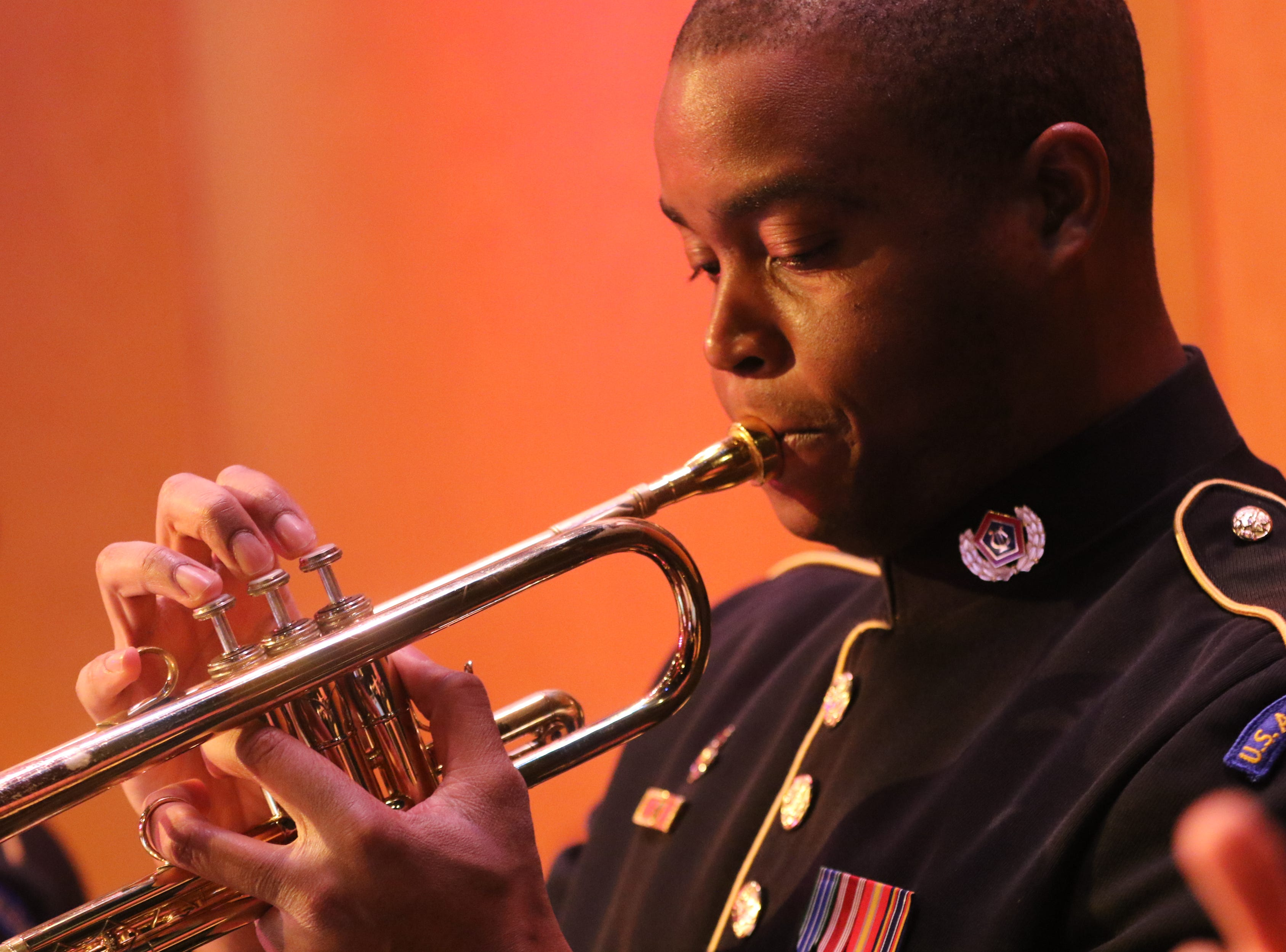 Sgt. First Class Thomas plays the trumpet, in Wayne.  The United States Army Jazz Ambassadors Field Band performed at Wayne Hills High School, Thursday, March 21, 2019.  This was the eleventh day of their tour, which lasts more than a month.