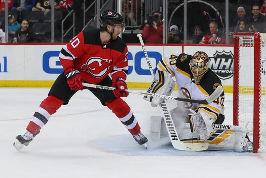 Mar 21, 2019; Newark, NJ, USA; Boston Bruins goaltender Tuukka Rask (40) makes a save on New Jersey Devils center Blake Coleman (20) during the second period at Prudential Center.