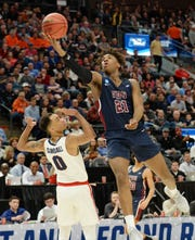 Mar 21, 2019; Salt Lake City, UT, USA; Fairleigh Dickinson Knights forward Elyjah Williams (21) shoots against Gonzaga Bulldogs guard Geno Crandall (0) in the second half in the first round of the 2019 NCAA Tournament at Vivint Smart Home Arena.