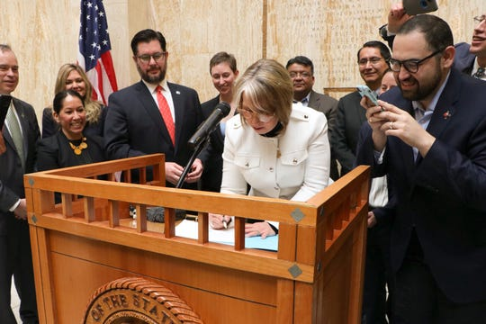 New Mexico Gov. Michelle Lujan Grisham on Friday, March 22, 2019, signs Senate Bill 489, the Energy Transition Act.