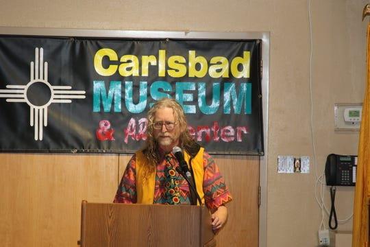 Michael Bromka reads a poem in tribute to Lynn Pitcaithley newest inductee into the Carlsbad Hall of Fame on March 22.