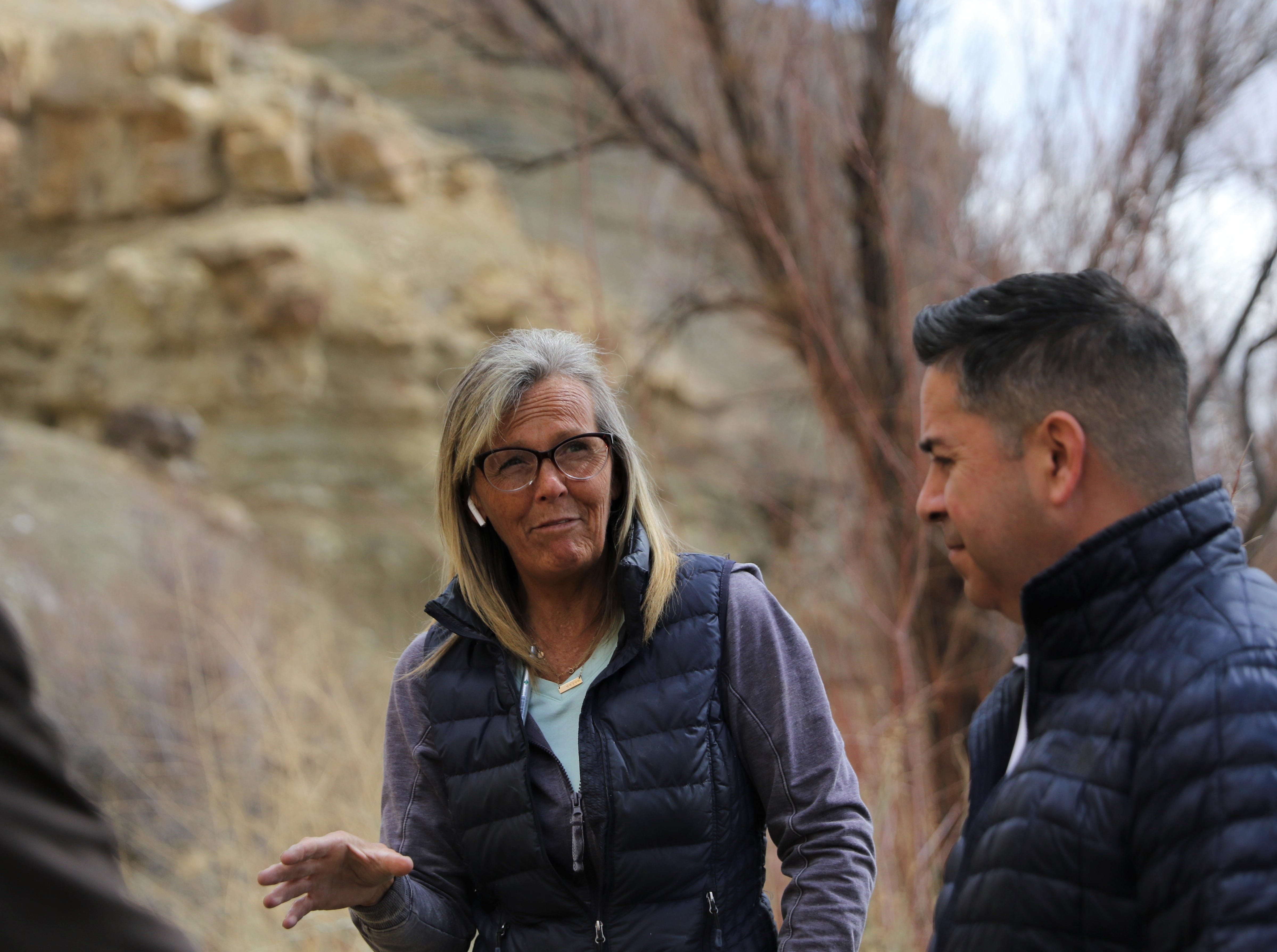 Farmers Mutual Ditch President Danene Sherwood discuss funding options with U.S. Rep. Ben Ray Lujan, D-NM, Friday, March 22, 2019, at the base of Harper Hill.