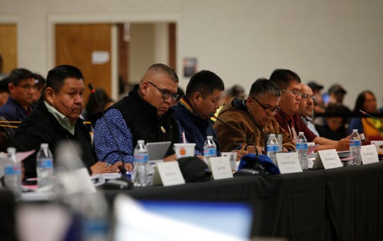 Navajo Nation Council delegates listen to comments on Thursday about a bill to support a sole move by the Navajo Transitional Energy Company to acquire the Navajo Generating Station and Kayenta Mine.