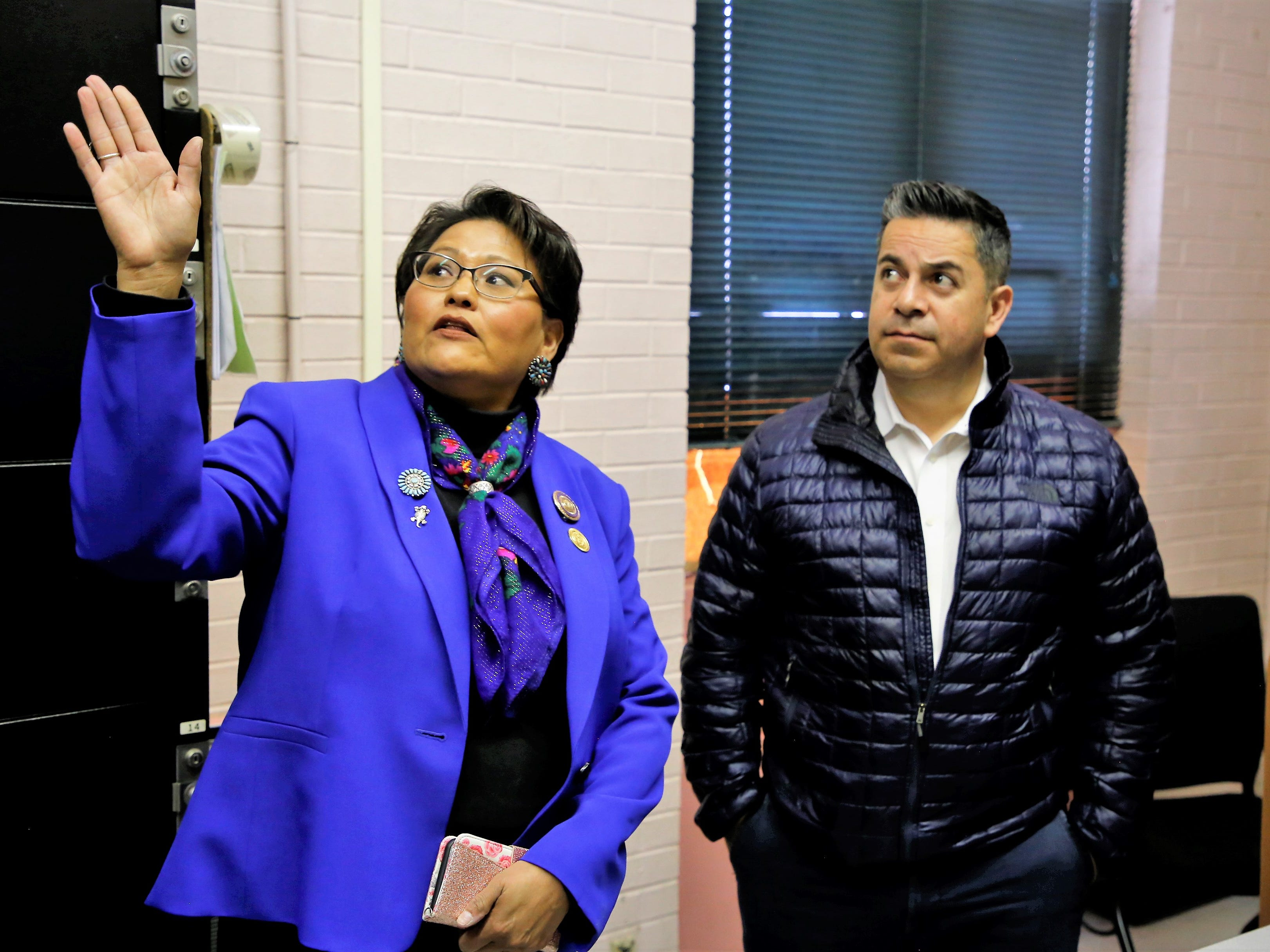 Delegate Eugenia Charles-Newton, left, who represents Shiprock Chapter, speaks to U.S. Rep. Ben Ray Luján, D-N.M. about the condition of the Shiprock Police Department during a tour Friday.