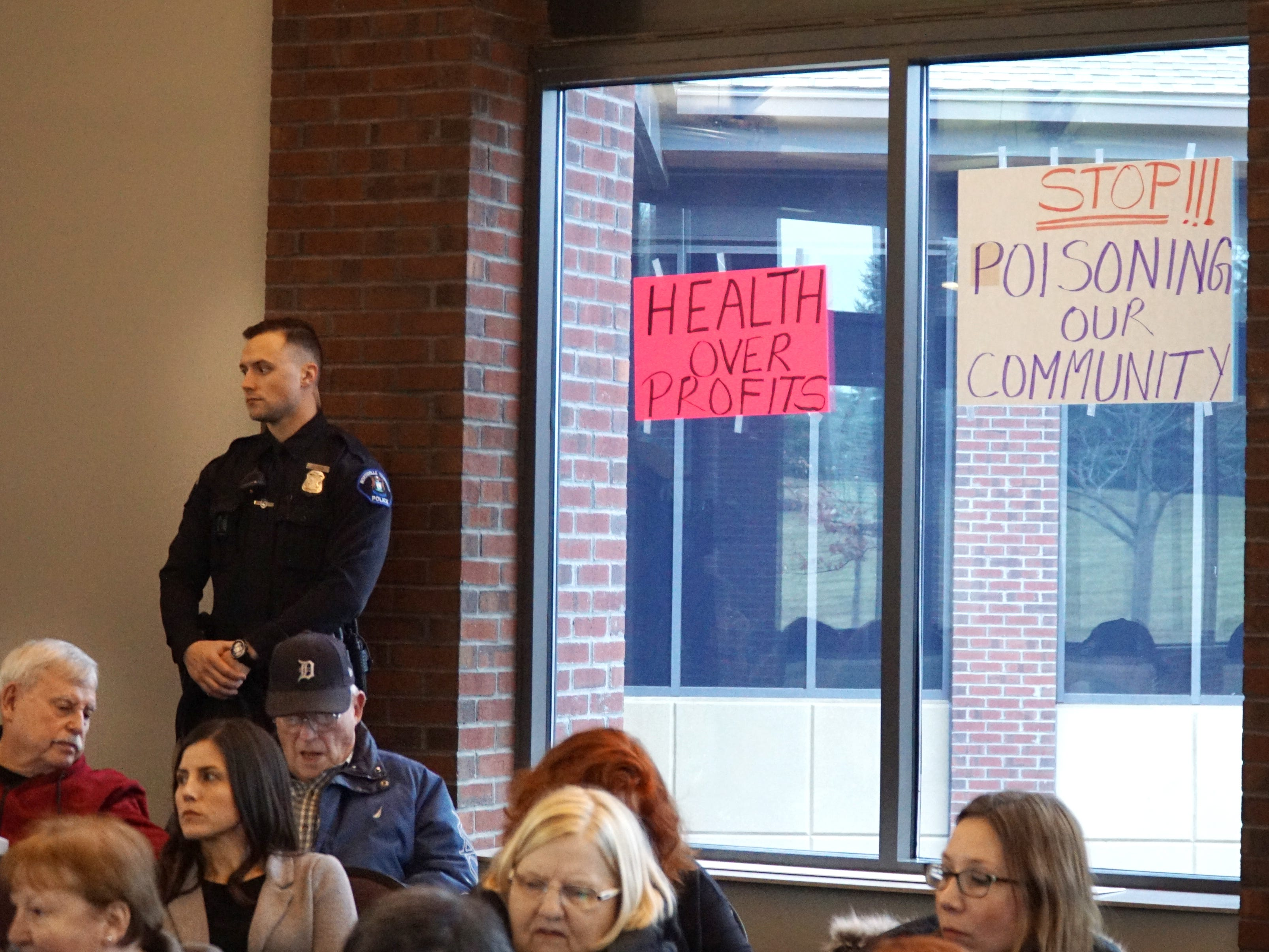 Some in attendance of the March 21 meeting posted signs on the windows of the meeting room - expressing their displeasure with the landfill and efforts to mitigate its smell and toxic releases.