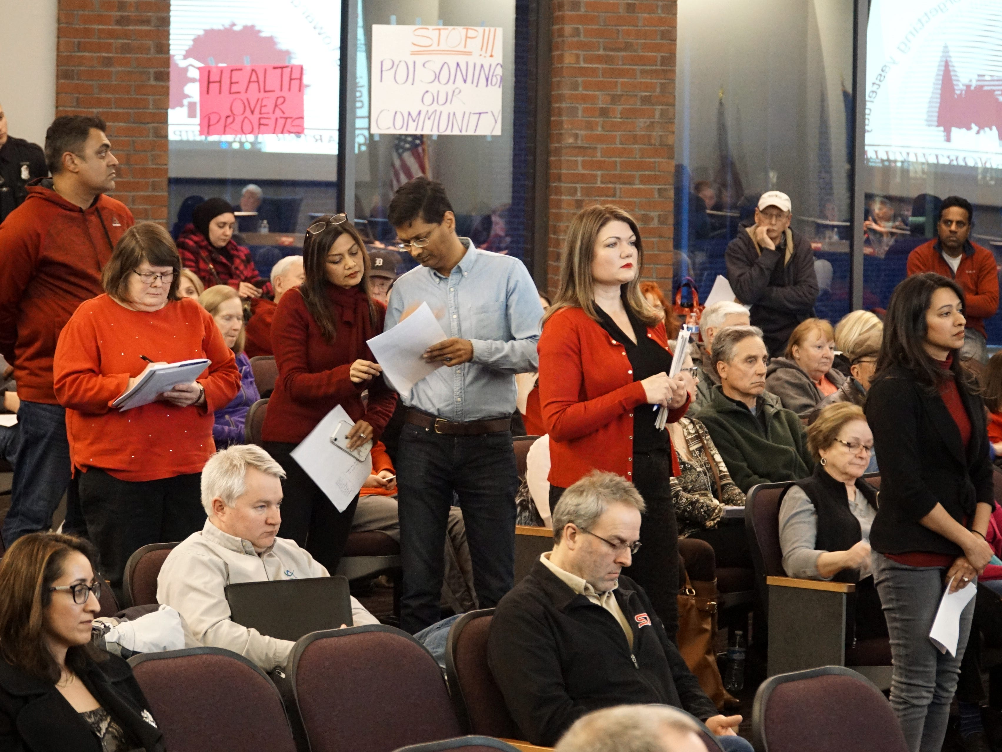 A line of residents waits to address the township trustees on March 21.