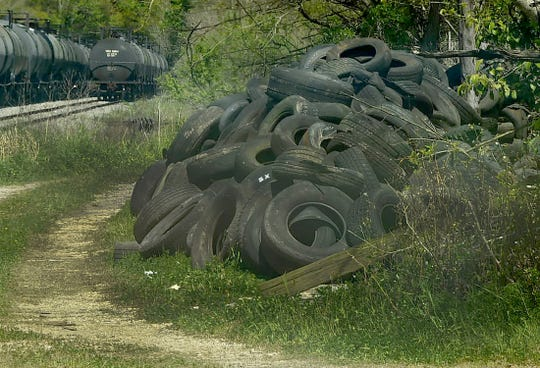 A mound of discarded tires is stacked at the former municipal dump site just inside the Opelousas city limits. Parish cleanup crews will begin on Monday removing the tires where they will be sent to a Lafayette-area business which will dispose of the tires according to state regulations.