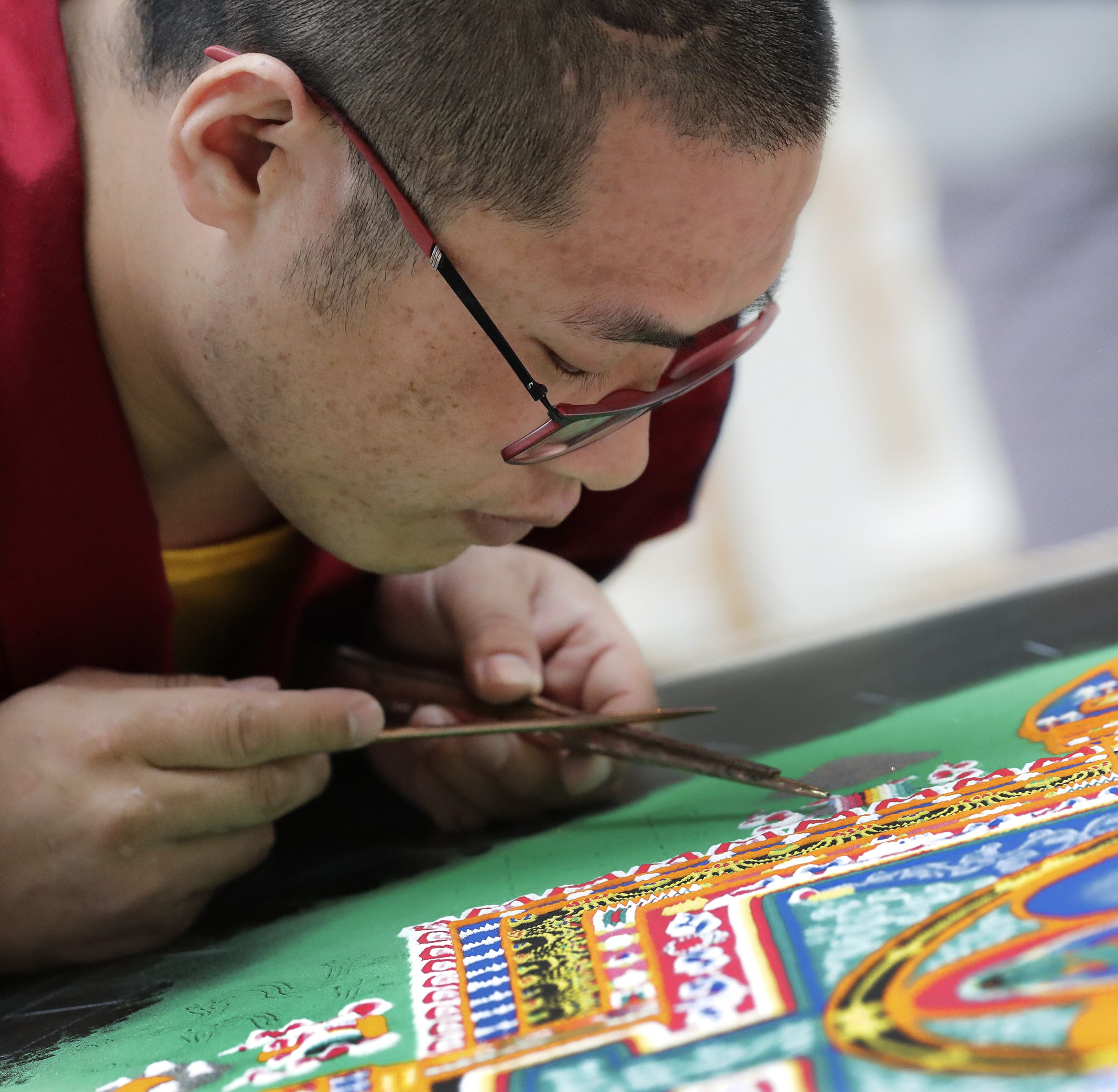 Buddhist monks from South India visit the Paine, create 'compassion' sand mandala