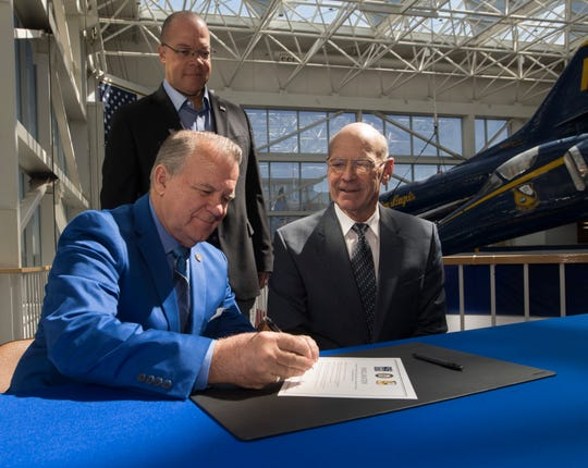 State Senator Doug Broxson is sponsoring legislation to add a Blue Angels license plate option for Florida drivers as Lt. Gen Duane Thiessen and Rep. Mike Hill look on during a press conference at the National Museum of Naval Aviation on Friday, March 22, 2019.
