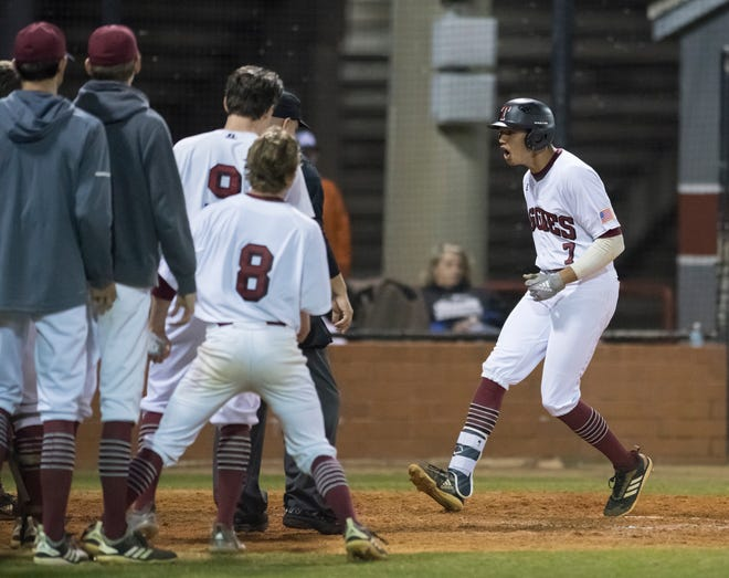 Raymond LaFleur (7)'s crosses the plate on a two-run homerun and a Aggie 5-3 lead during the 2019 Aggie Classic championship baseball game between Choctaw and Tate at Tate High School in Cantonment on Thursday, March 21, 2019.  LaFleur was drafted by the Los Angeles Dodgers in the 21st round of the MLB Draft.