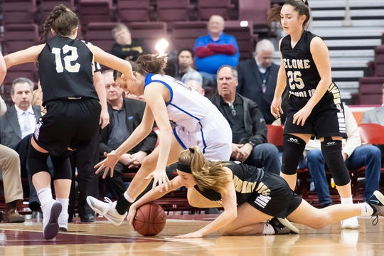 Delone Catholic's Riley Vingsen goes to the ground to get the ball during the PIAA 3A championship game against Dunmore at the Giant Center in Hershey on Thursday, March 21, 2019. Delone won 49-43.