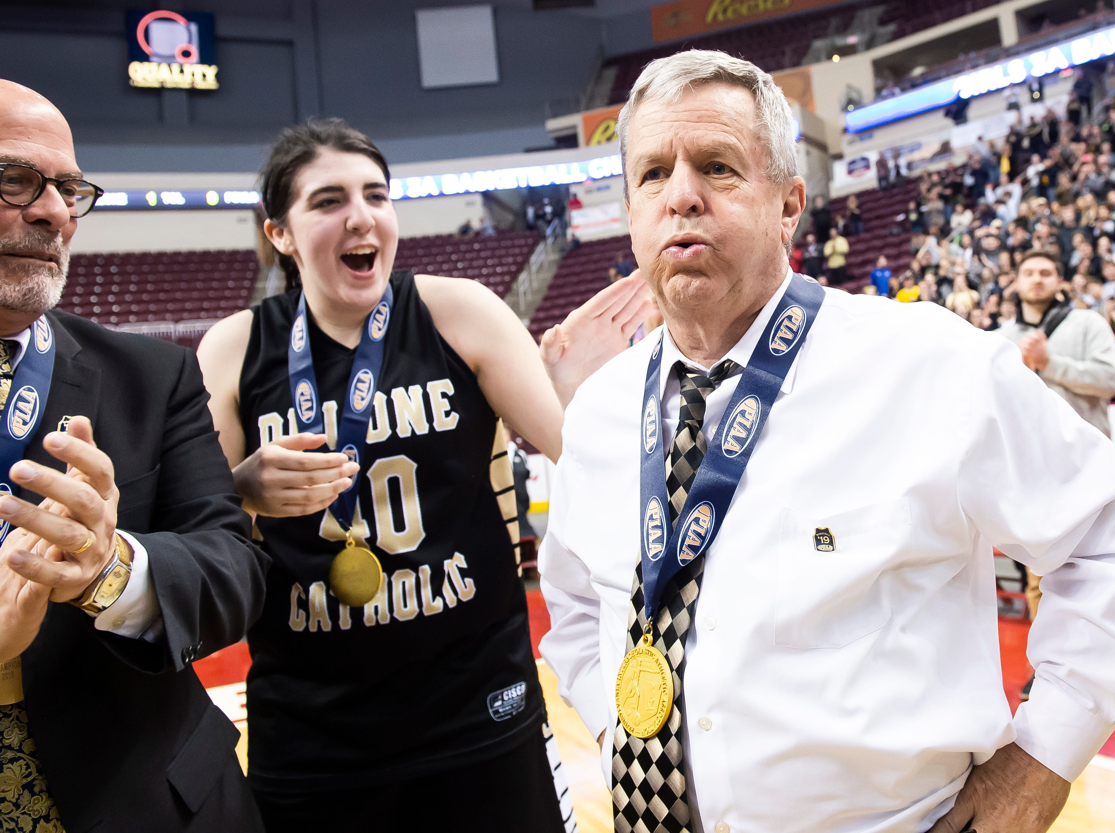 Delone Catholic head coach Gerry Eckenrode lets out a deep breath after the Squirettes defeated Dunmore 49-43 in the PIAA 3A championship game at the Giant Center in Hershey on Thursday, March 21, 2019.