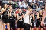 Coach Gerry Eckenrode and Delone Catholic players reflect on the girls' basketball team's 49-43 victory against Dunmore in the state championship on Thursday night.
