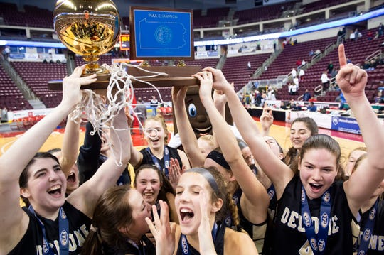 The Delone Catholic Squirettes celebrate after defeating Dunmore 49-43 in the PIAA 3A championship game at the Giant Center in Hershey on Thursday, March 21, 2019. The Squirettes handed Dunmore (29-1) their first loss of the season and claimed their first state championship in 14 years.