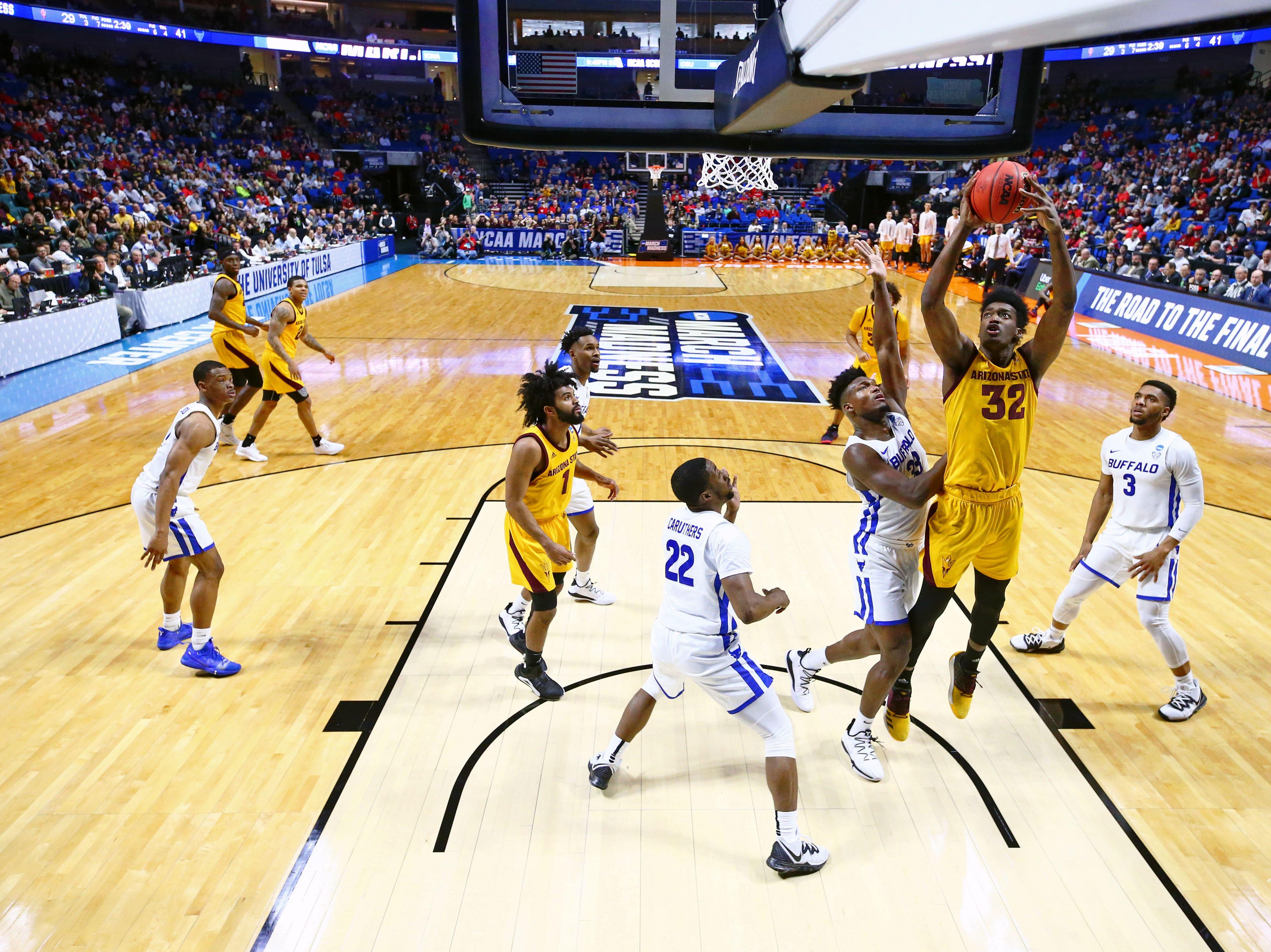 Mar 22, 2019; Tulsa, OK, USA; Arizona State Sun Devils forward De'Quon Lake (32) shoots while defended by Buffalo Bulls forward Nick Perkins (33) during the first half in the first round of the 2019 NCAA Tournament at BOK Center. Mandatory Credit: Mark J. Rebilas-USA TODAY Sports