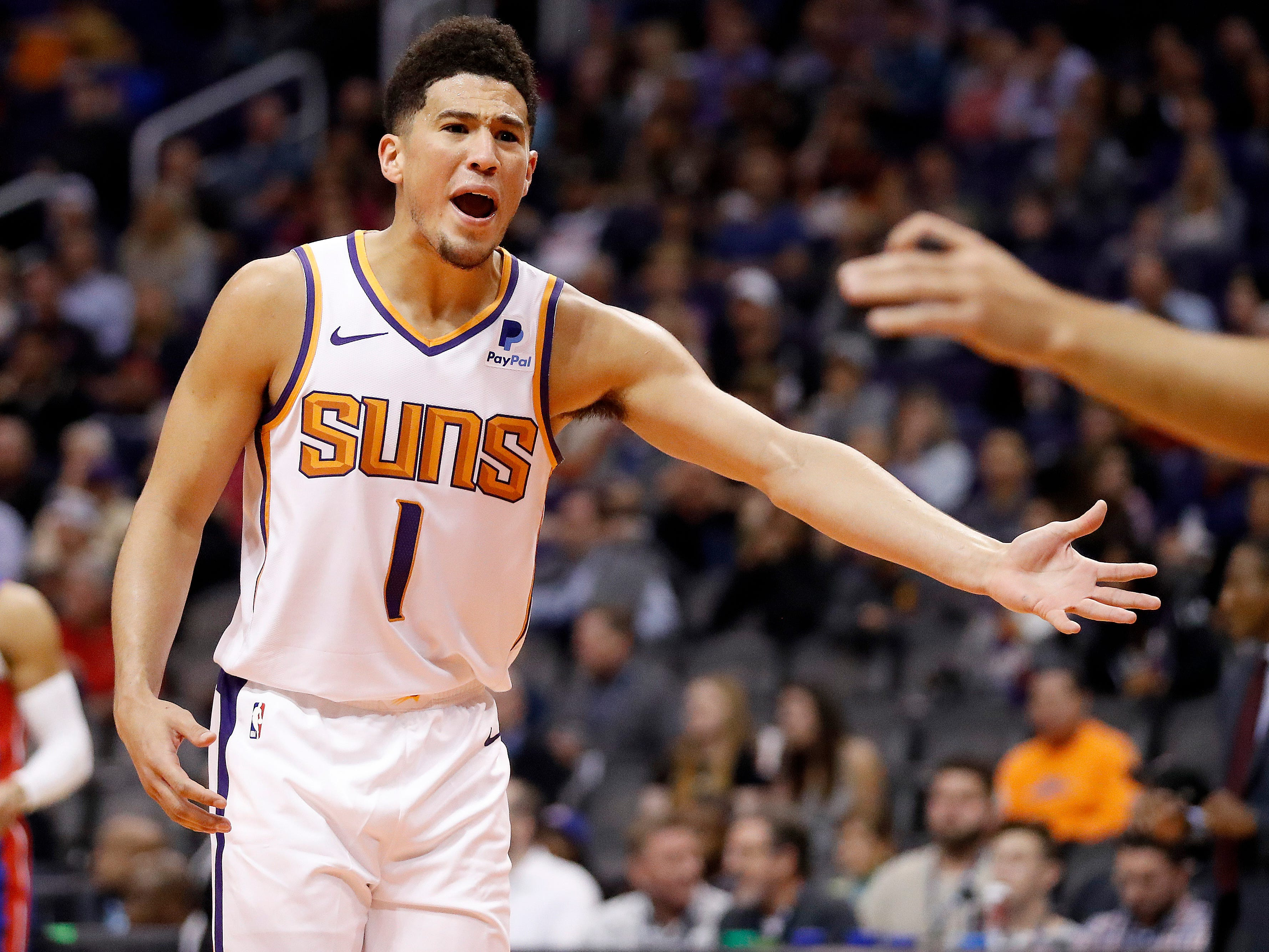 Phoenix Suns guard Devin Booker (1) argues with an official after being called for a technical foul during the second half of the team's NBA basketball game against the Detroit Pistons, Thursday, March 21, 2019, in Phoenix.