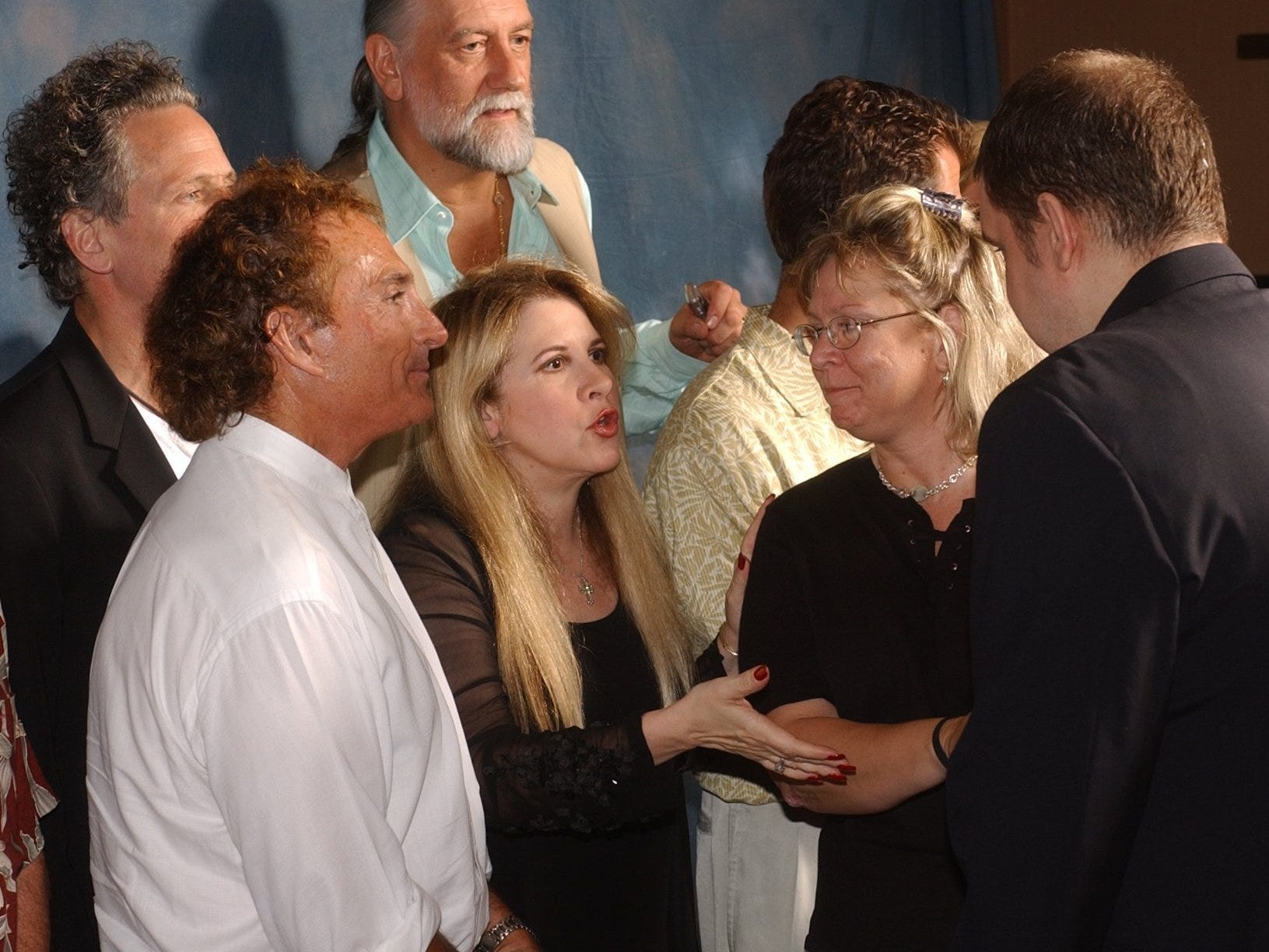 Stevie Nicks (center) shakes hands with Linda Anderson and Scott Williams before having pictures taken with them during a VIP party with Fleetwood Mac at Kincaid's in downtown Phoenix in 2003.
