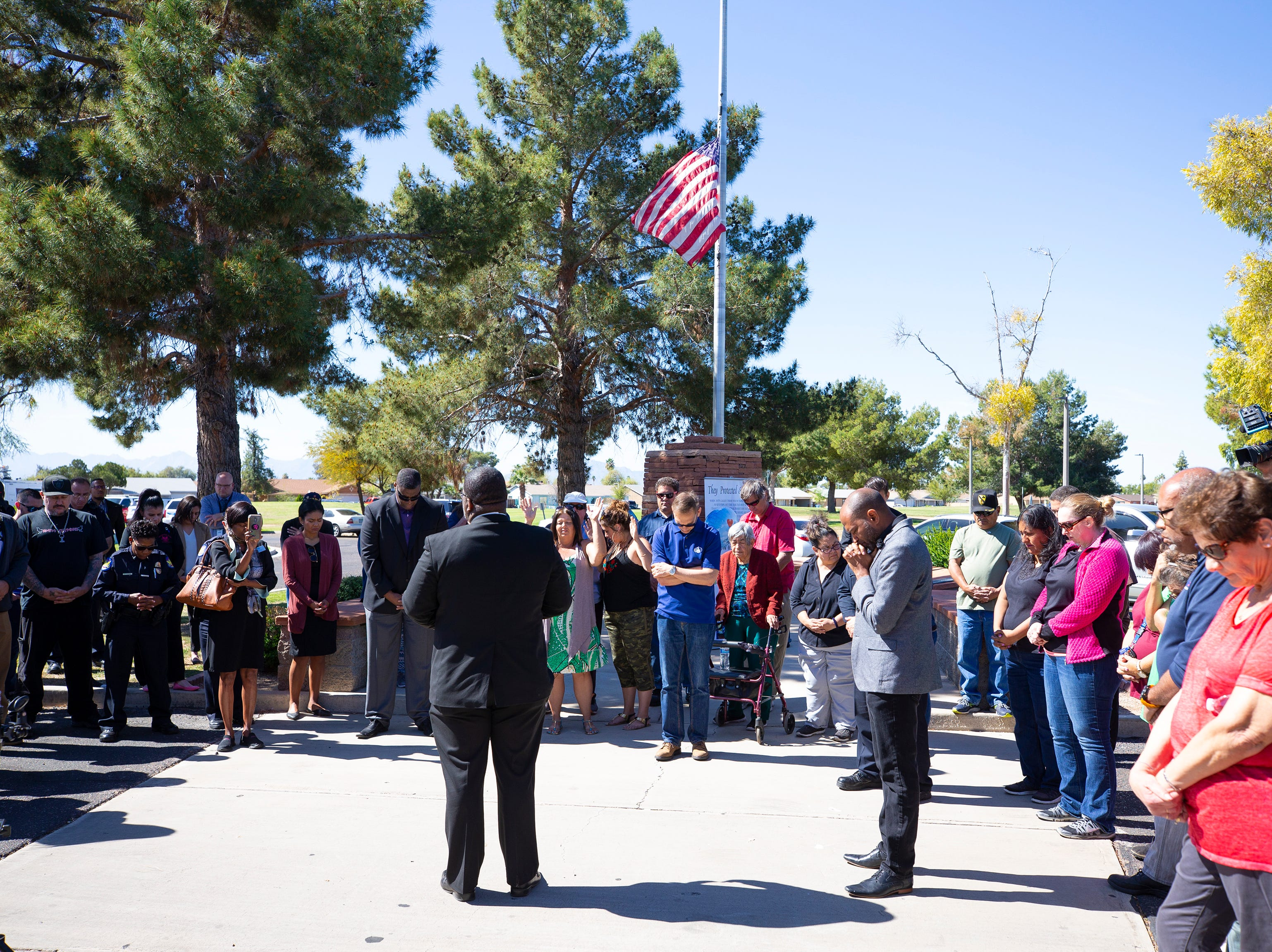 The Faith and Justice Project host a prayer service March 22, 2019, outside Phoenix Police Maryvale Precinct for Officer Paul Rutherford, who was killed in a crash March 21.