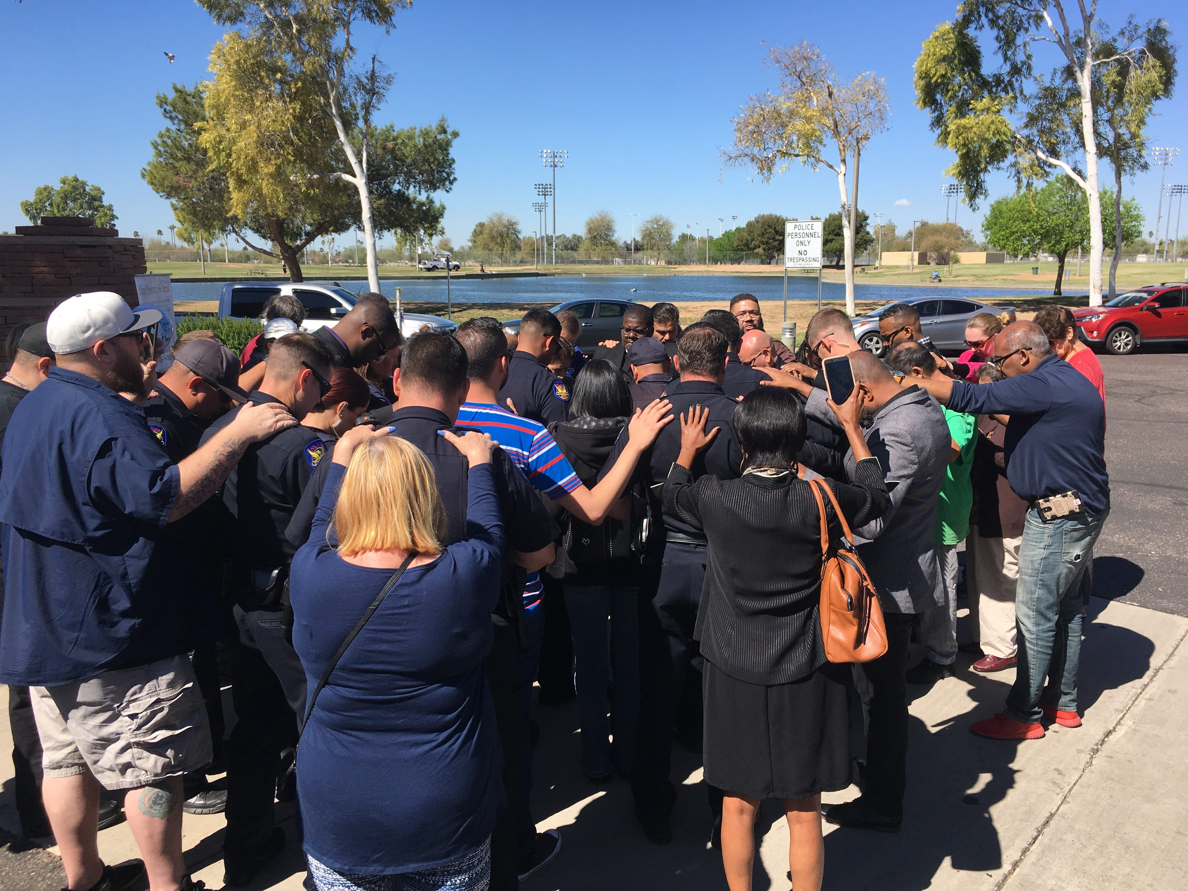 A group gathered Friday morning to pray for the family and fellow Phoenix police officers of Paul Rutherford, an officer who died Thursday when he was struck by a vehicle while at a crash.