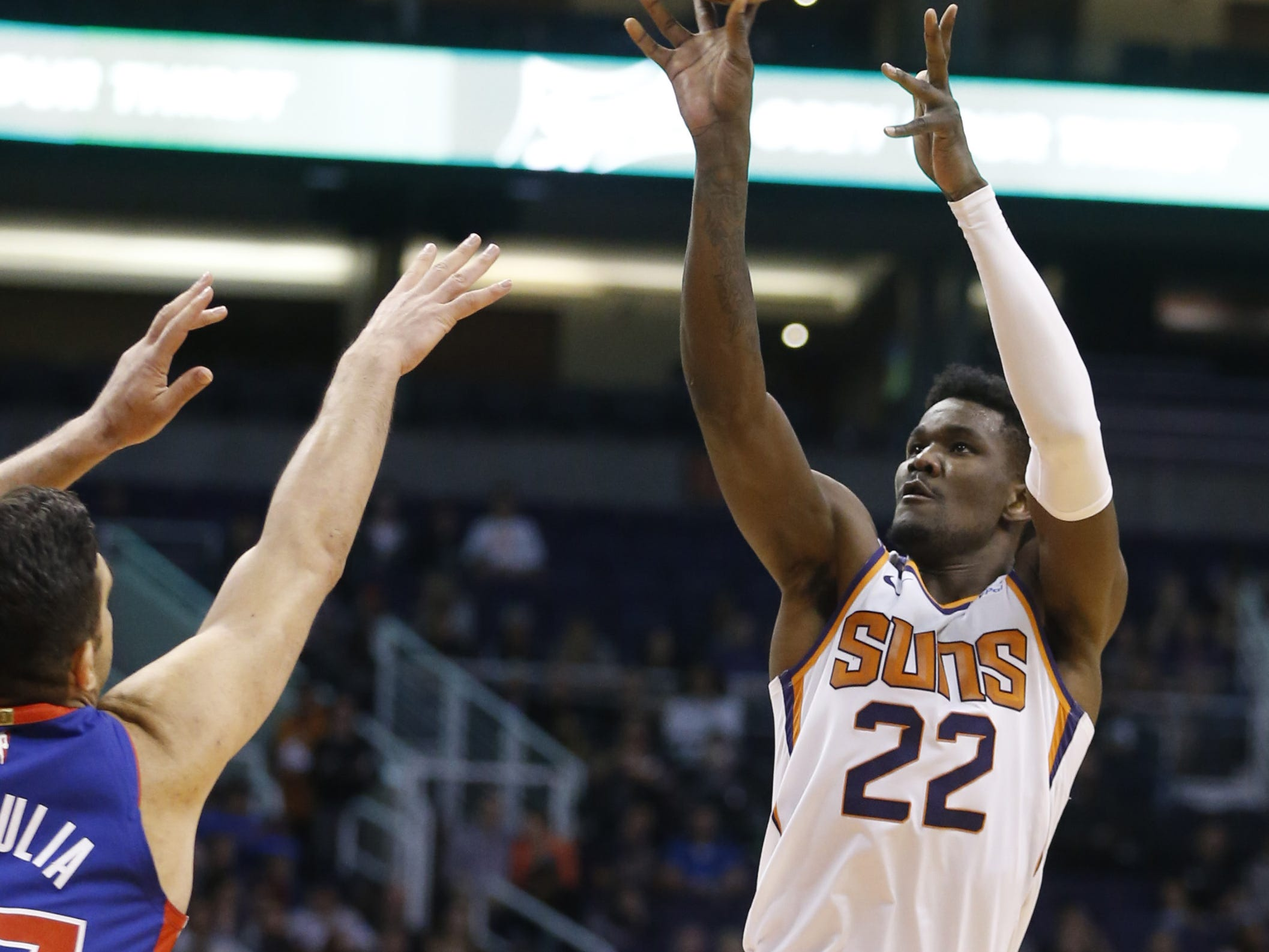 Suns' Deandre Ayton (22) shoots against Pistons' Zaza Pachulia during the first half at the Talking Stick Resort Arena in Phoenix, Ariz. on March 21, 2019.
