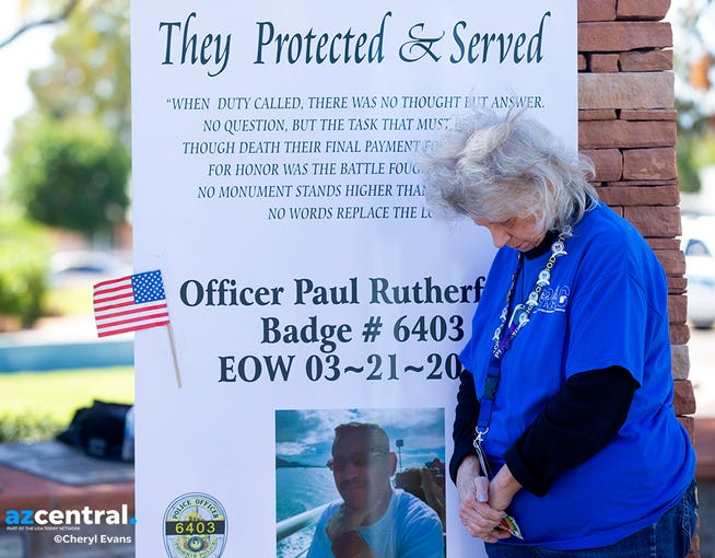 Carol Hobbs attends a prayer service March 22, 2019, outside Phoenix Police Maryvale Precinct for Officer Paul Rutherford, who was killed in a crash March 21.