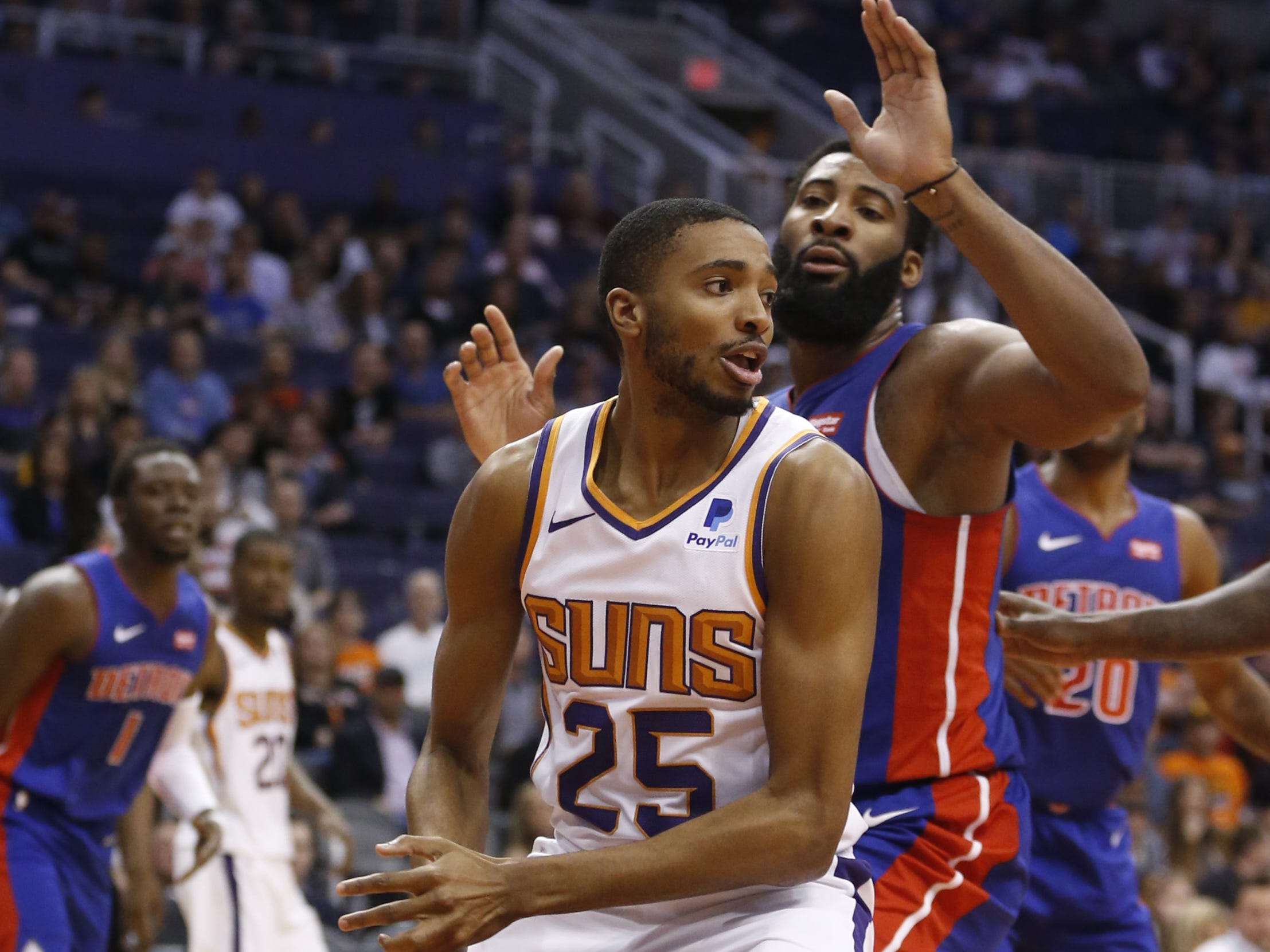 Suns' Mikal Bridges (25) dribbles in the post against Pistons' Andre Drummond (0) during the first half at the Talking Stick Resort Arena in Phoenix, Ariz. on March 21, 2019.